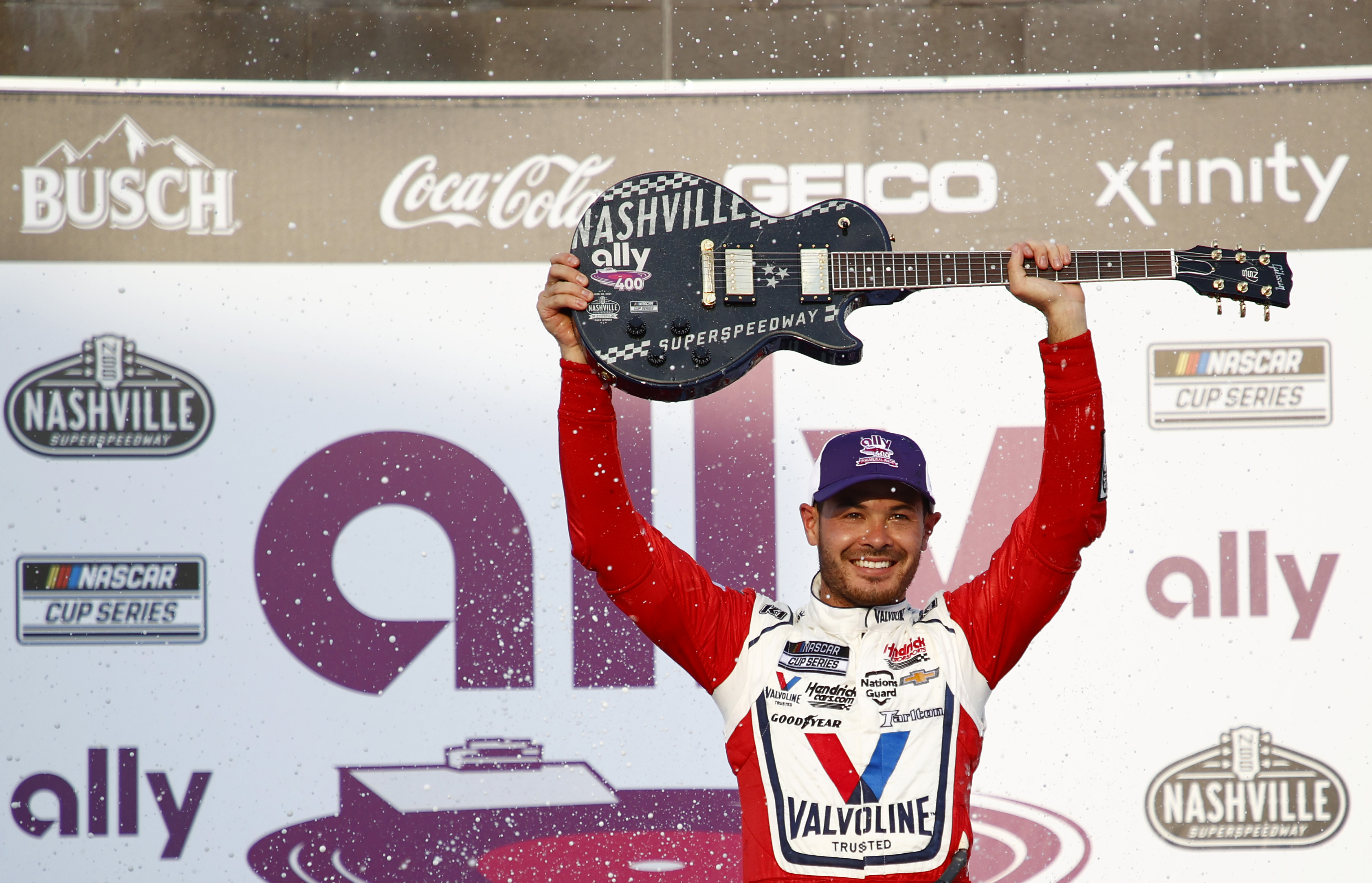 Kyle Larson, driver of the Valvoline Chevrolet, celebrates in victory lane after winning the NASCAR Cup Series Ally 400 at Nashville Superspeedway on June 20, 2021 in Lebanon, Tennessee.