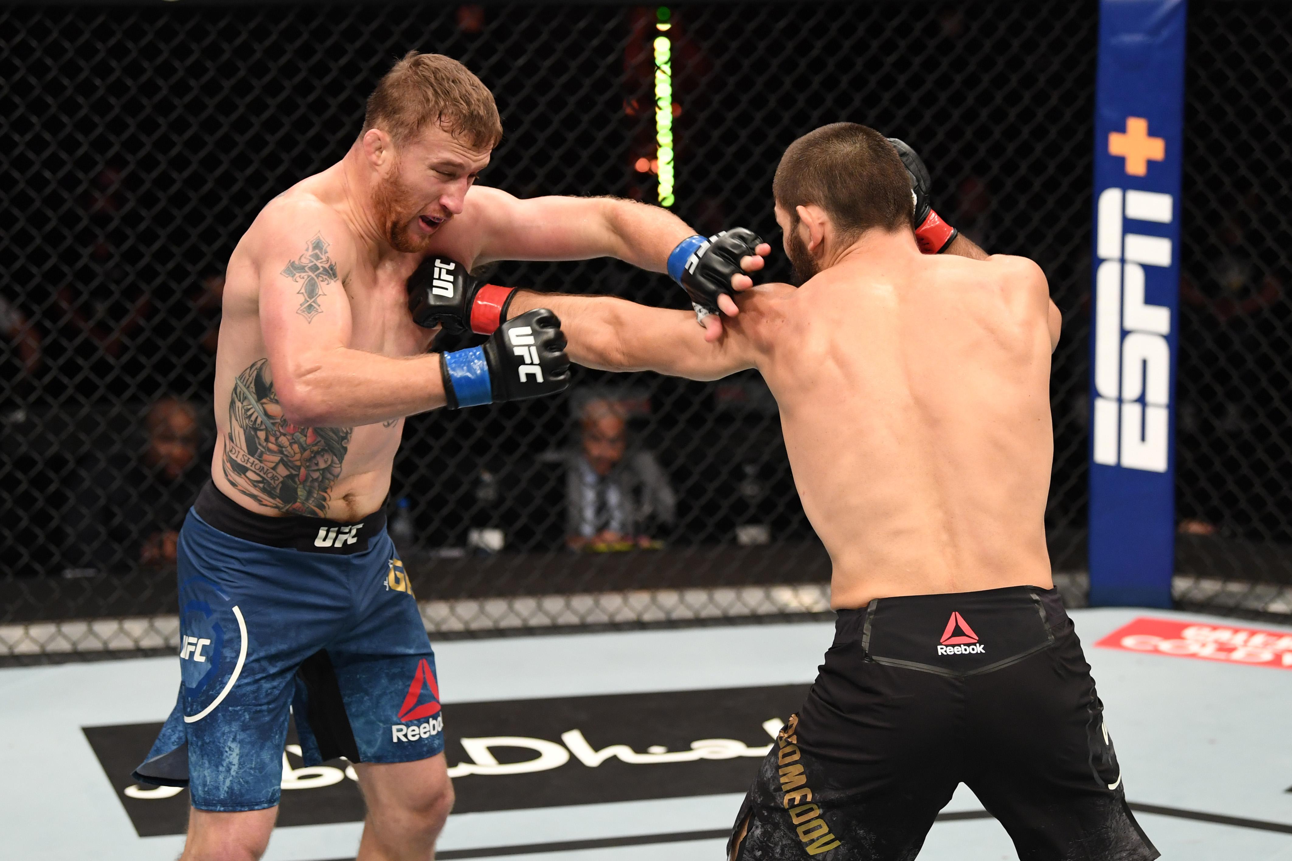 Justin Gaethje takes a punch from Khabib Nurmagomedov at UFC 254.