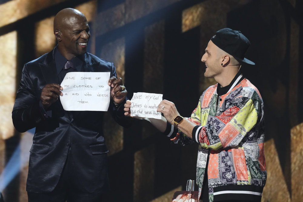 """Magician Dustin Tavella, right, involves """"AGT"""" host Terry Crews in his routine for the """"AGT"""" finale performance."""