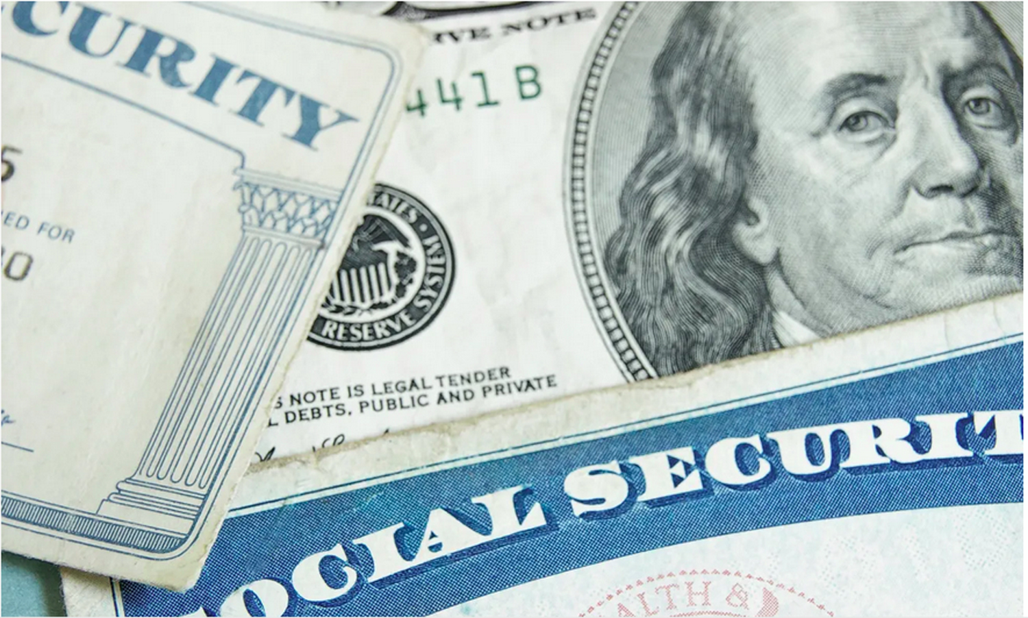 Money sitting on top of Social Security check.