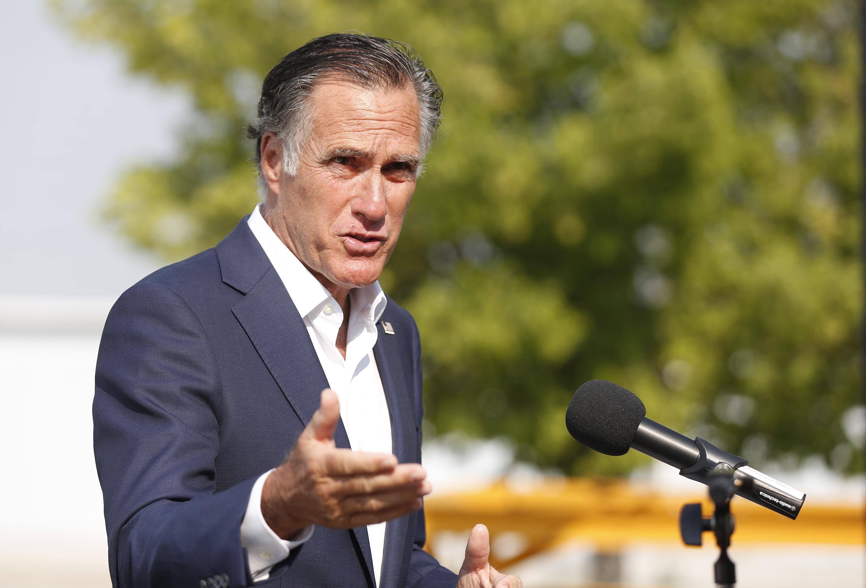 Utah Sen. Mitt Romney speaks to reporters in Salt Lake City.