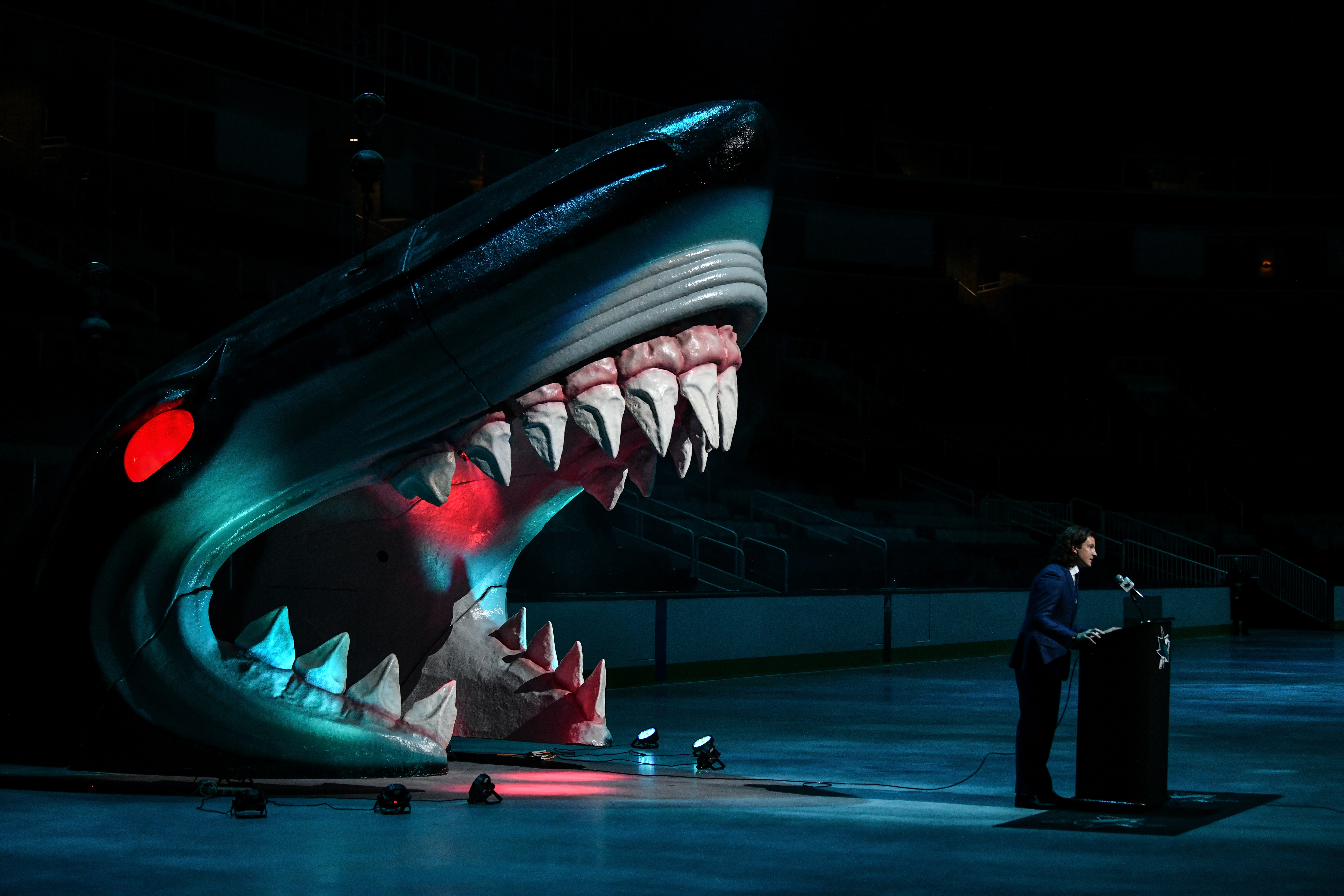 San Jose Sharks Director of Scouting Doug Wilson Jr. stands at the podium as the Sharks select William Eklund seventh overall in the first round during the 2021 NHL Draft at SAP Center on July 23, 2021 in San Jose, California.