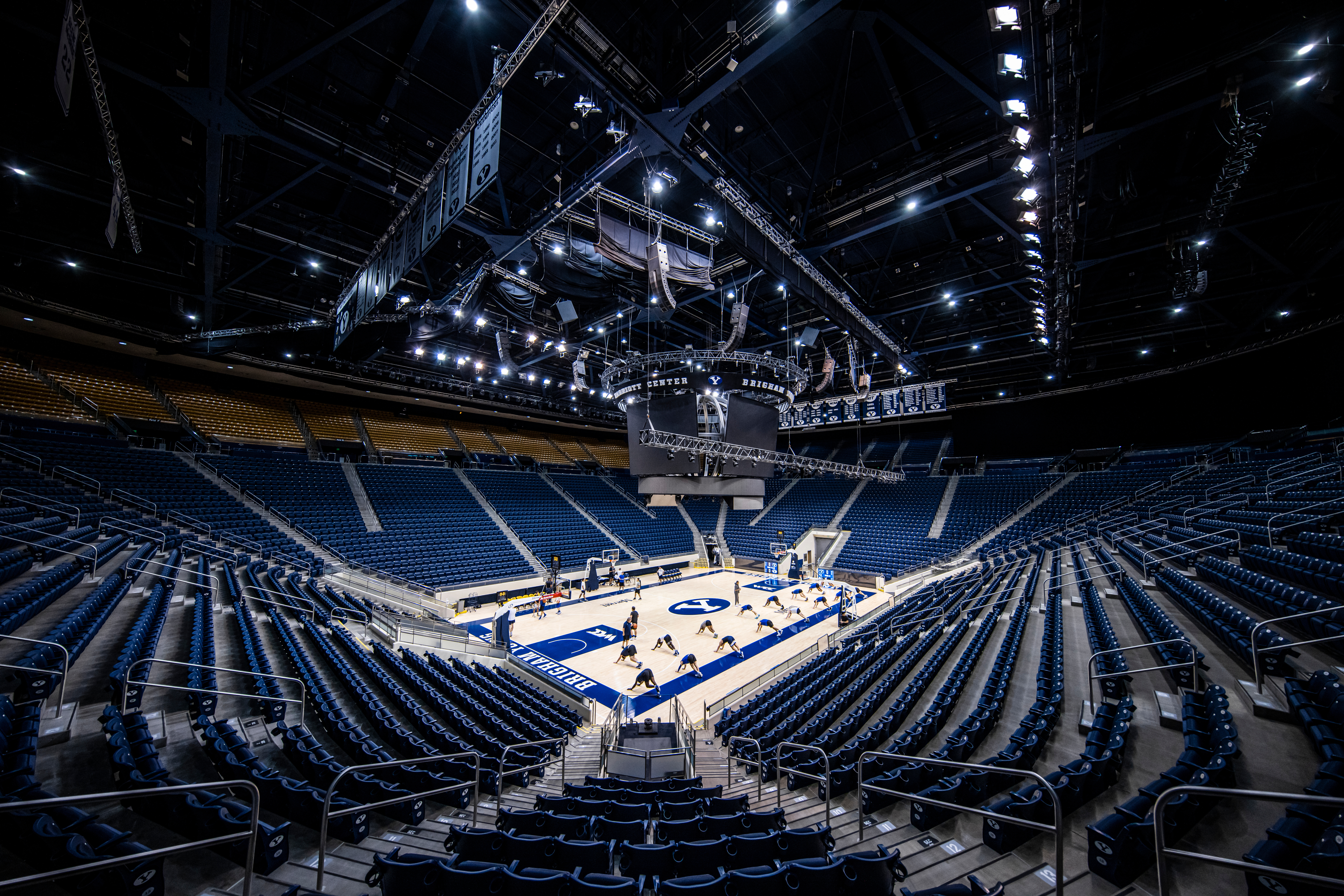 Members of the BYU basketball team stretch prior to a workout in the Marriott Center at BYU in Provo, Utah.