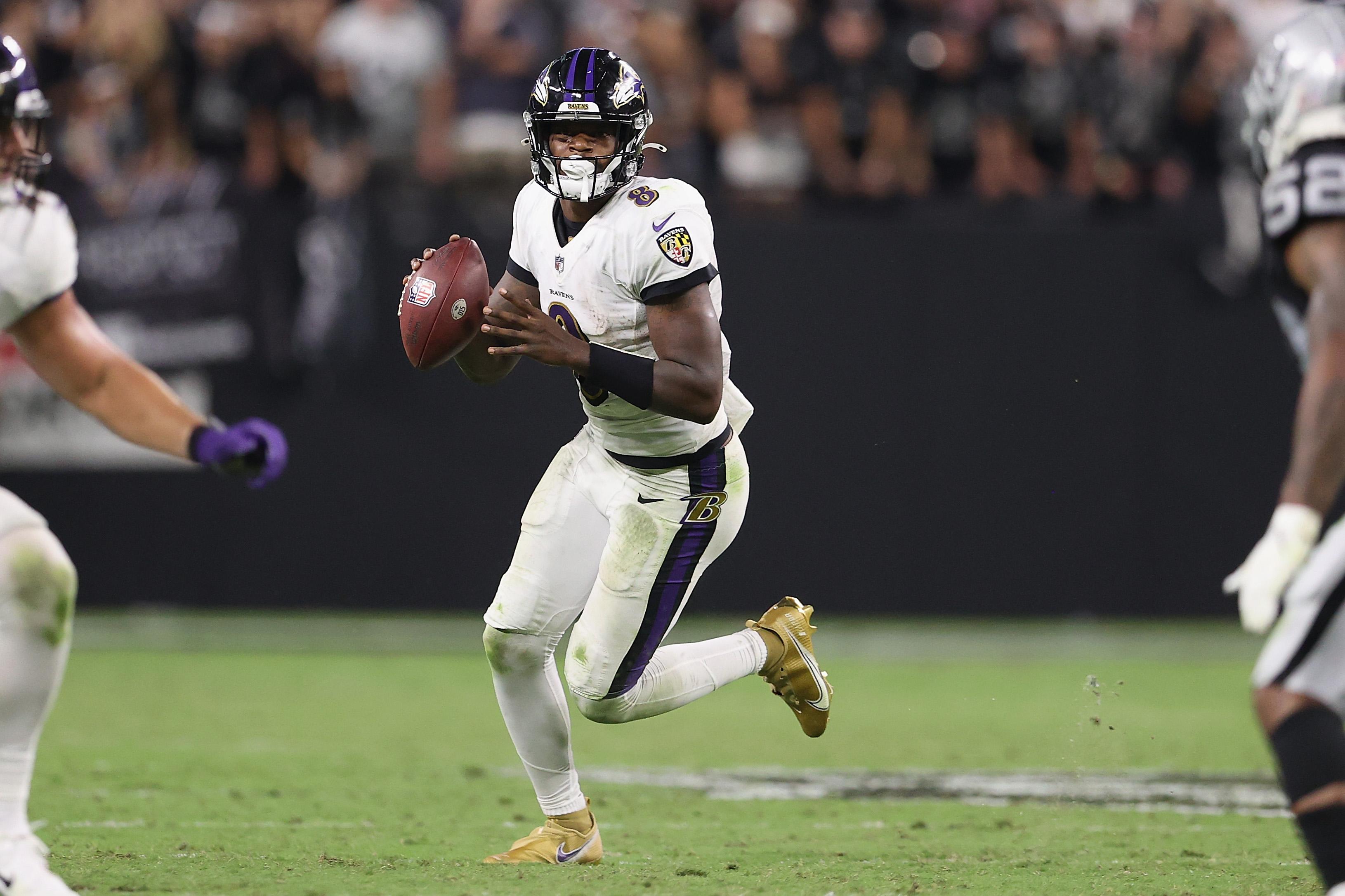 Quarterback Lamar Jackson #8 of the Baltimore Ravens looks to pass during the NFL game against the Las Vegas Raiders at Allegiant Stadium on September 13, 2021 in Las Vegas, Nevada.