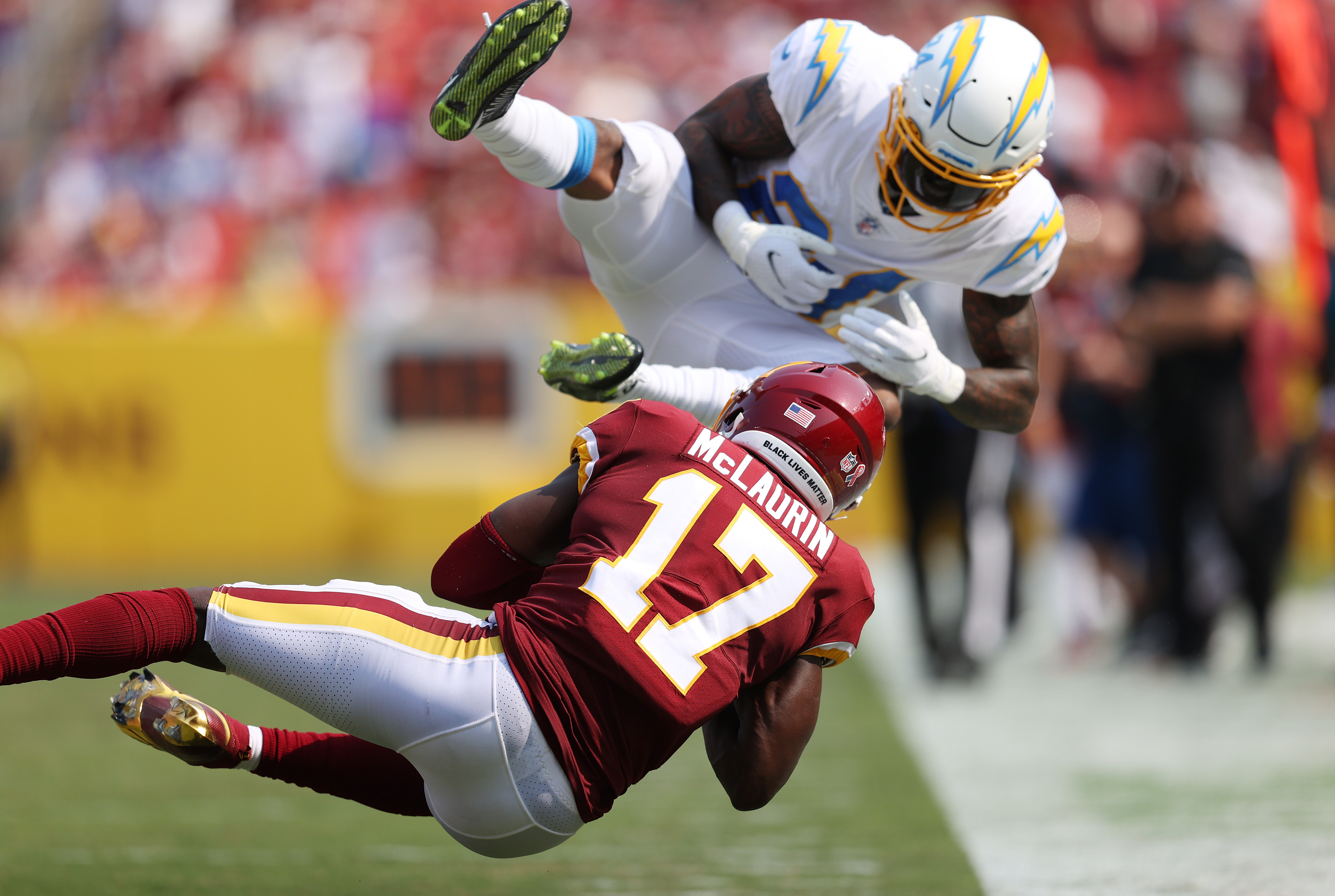 Terry McLaurin #17 of the Washington Football Team makes a catch against the Los Angeles Chargers during the fourth quarter at FedExField on September 12, 2021 in Landover, Maryland.