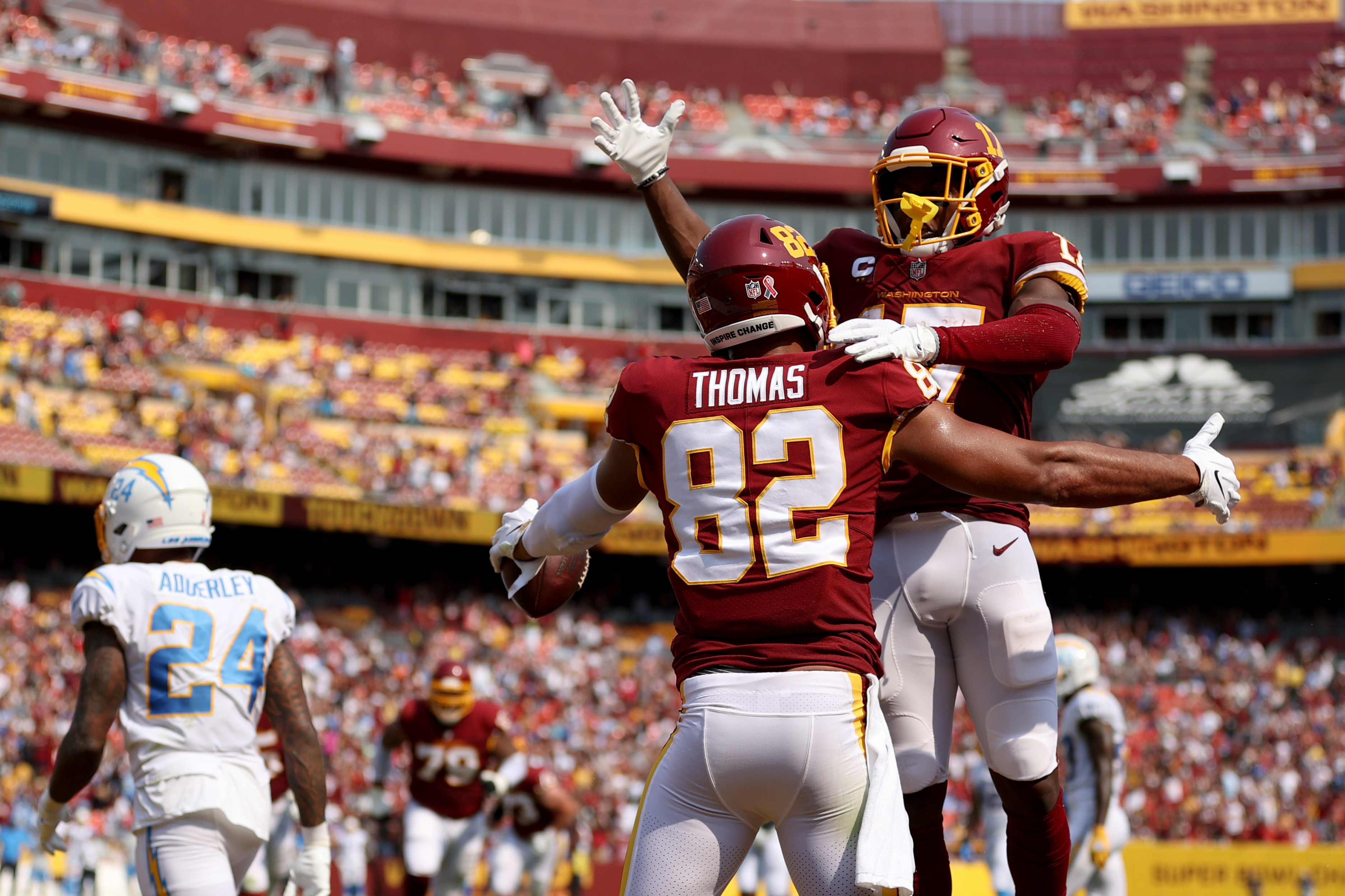 Logan Thomas #82 of the Washington Football Team celebrates his touchdown reception against the Los Angeles Chargers with Terry McLaurin #17 during the third quarter at FedExField on September 12, 2021 in Landover, Maryland.
