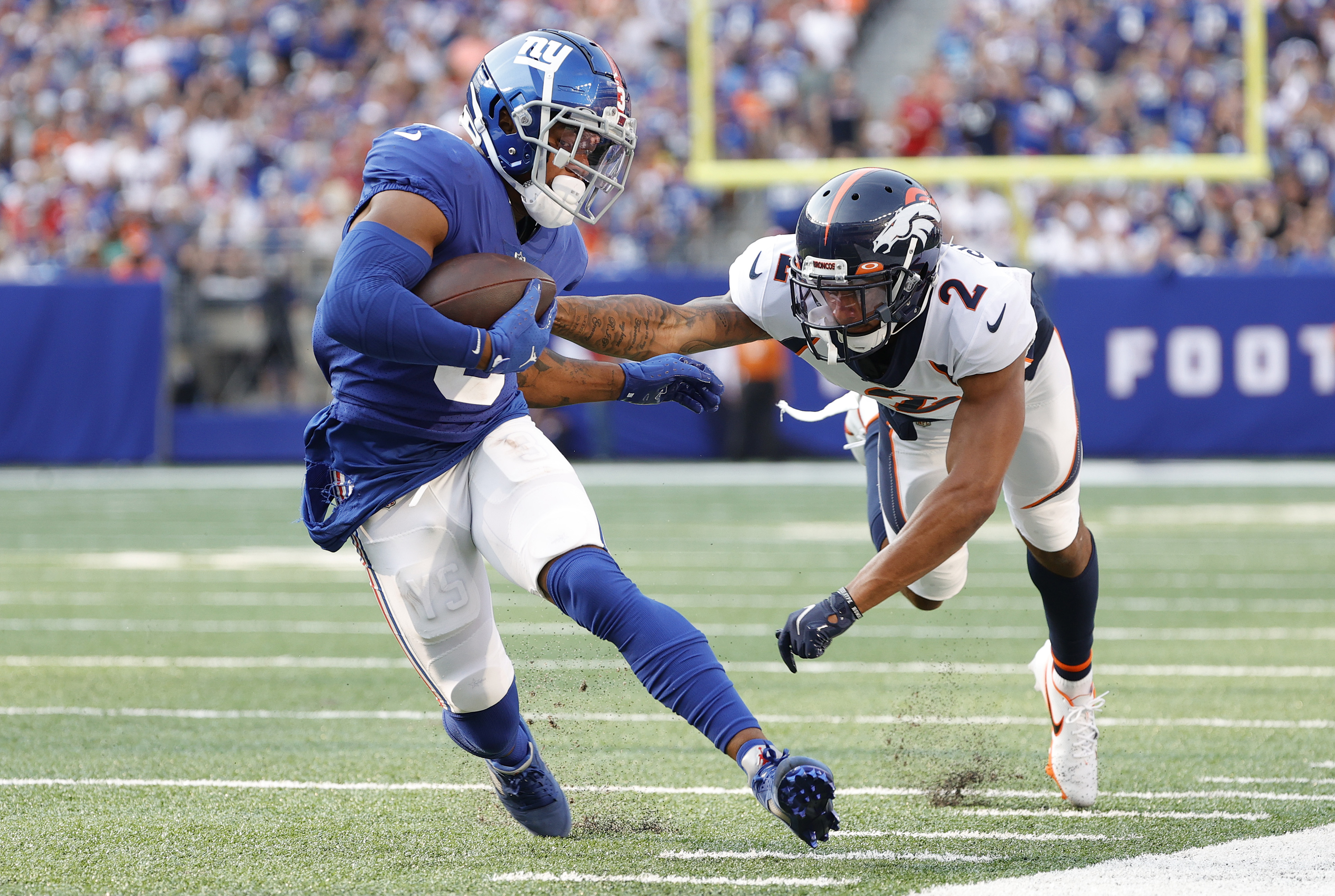 Sterling Shepard #3 of the New York Giants makes a catch against Pat Surtain II #2 of the Denver Broncos during the first half at MetLife Stadium on September 12, 2021 in East Rutherford, New Jersey.