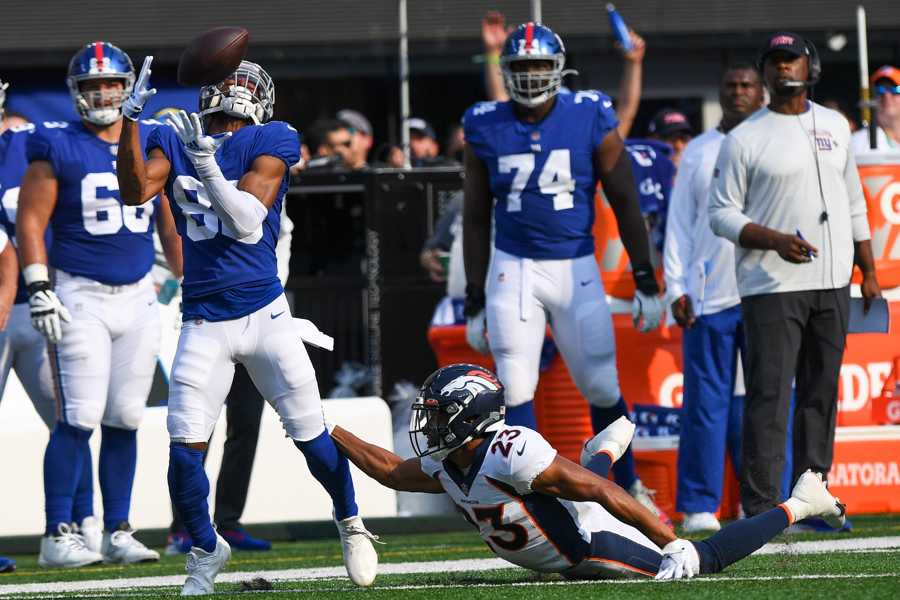 New York Giants wide receiver Darius Slayton (86) makes a catch defended by Denver Broncos cornerback Kyle Fuller (23) during the first half at MetLife Stadium.