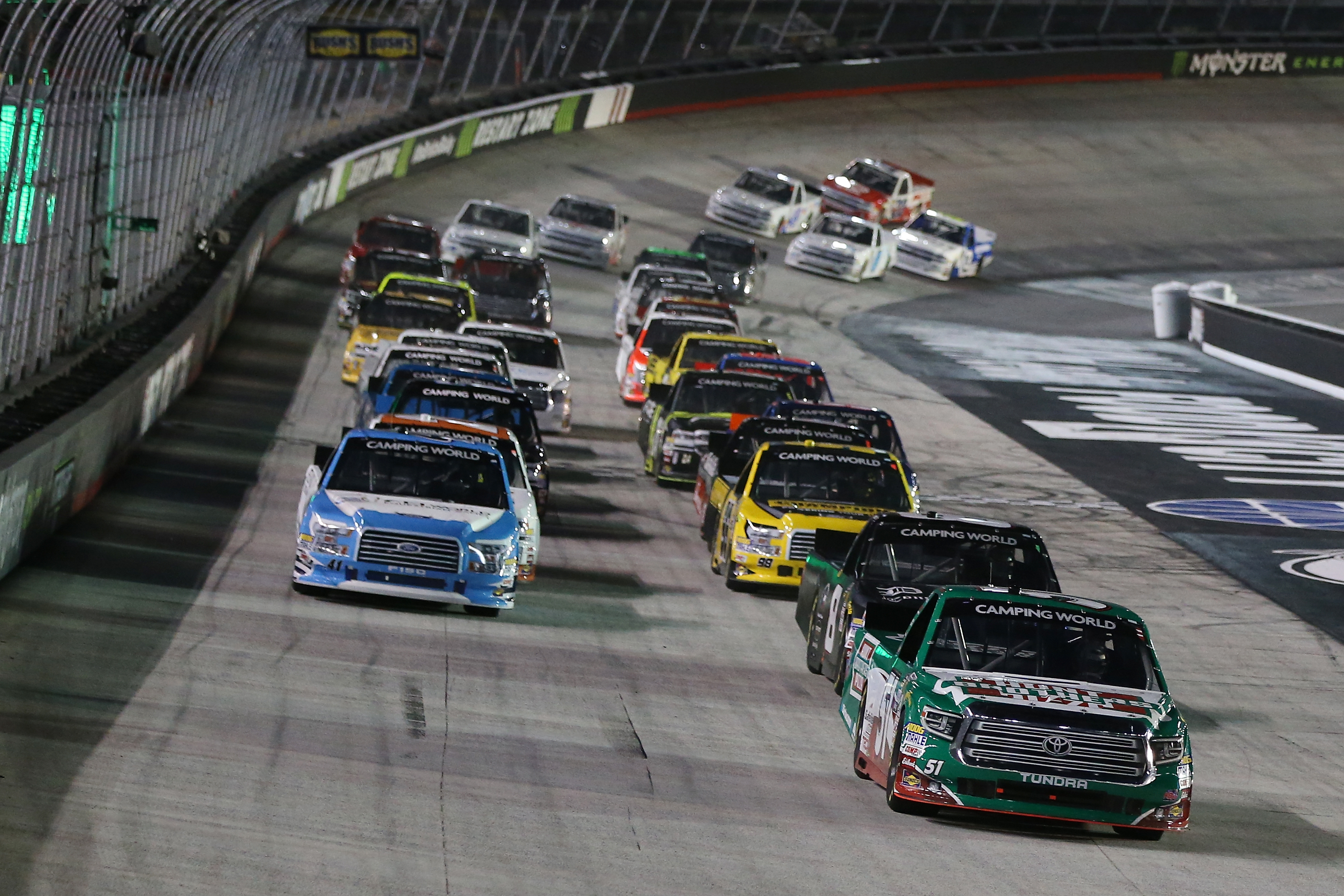 Christopher Bell, driver of the #51 Hunt Brothers Pizza Toyota, and John Hunter Nemechek, driver of the #8 D.A.B. Constructors/Fleetwing Chevrolet, lead the field to green for the start of the NASCAR Camping World Truck Series UHOH 200 at Bristol Motor Speedway on August 16, 2018 in Bristol, Tennessee.