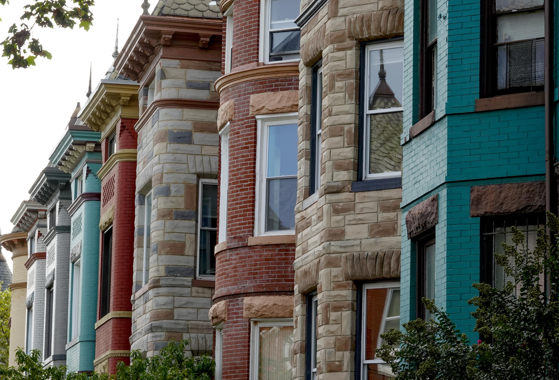 Rowhouse facades along a city street.