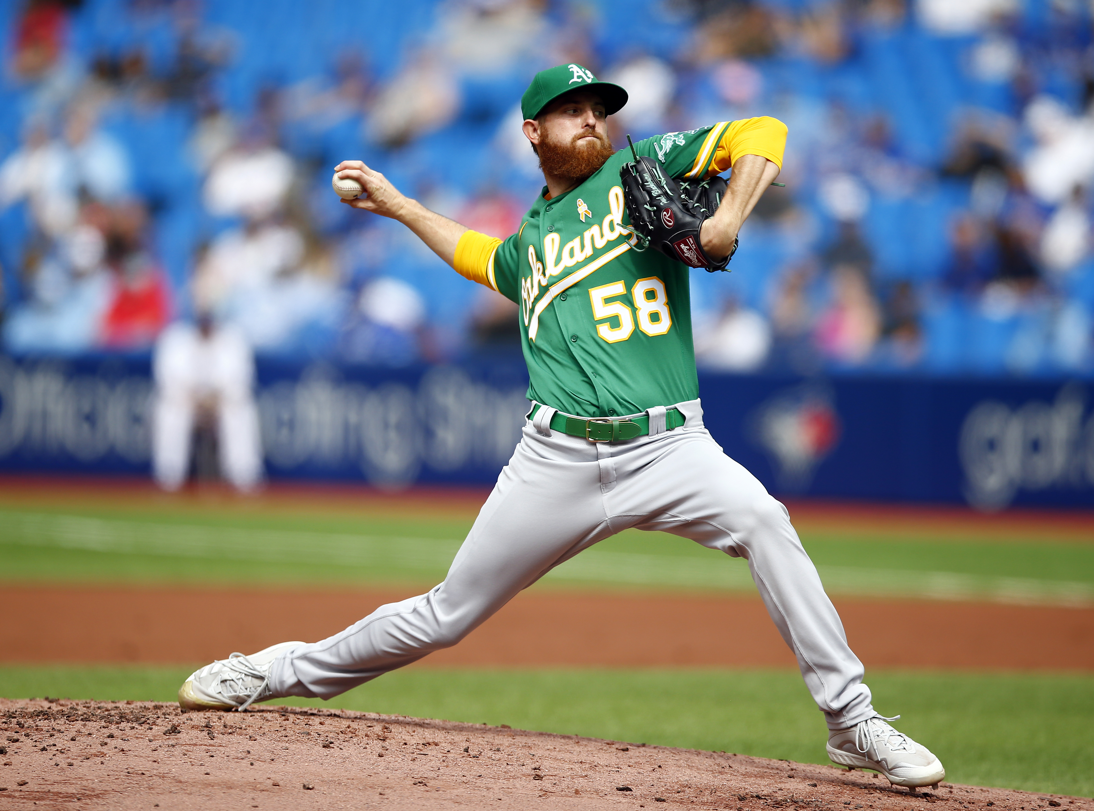 Paul Blackburn #58 of the Oakland Athletics delivers a pitch in the first inning during a MLB game against the Toronto Blue Jays at Rogers Centre on September 4, 2021 in Toronto, Ontario, Canada.