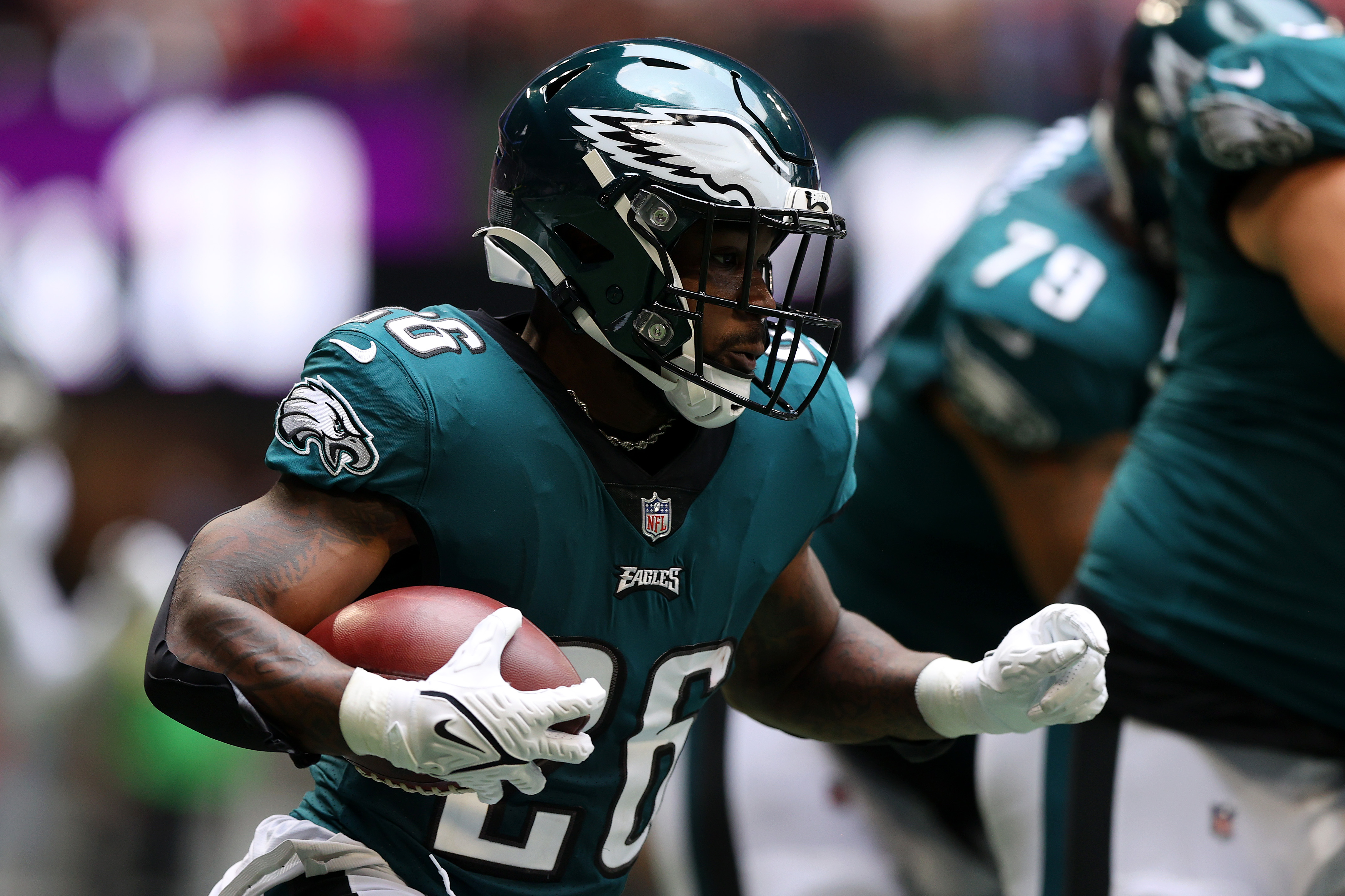 Miles Sanders #26 of the Philadelphia Eagles carries the ball against the Atlanta Falcons during the second quarter at Mercedes-Benz Stadium on September 12, 2021 in Atlanta, Georgia.