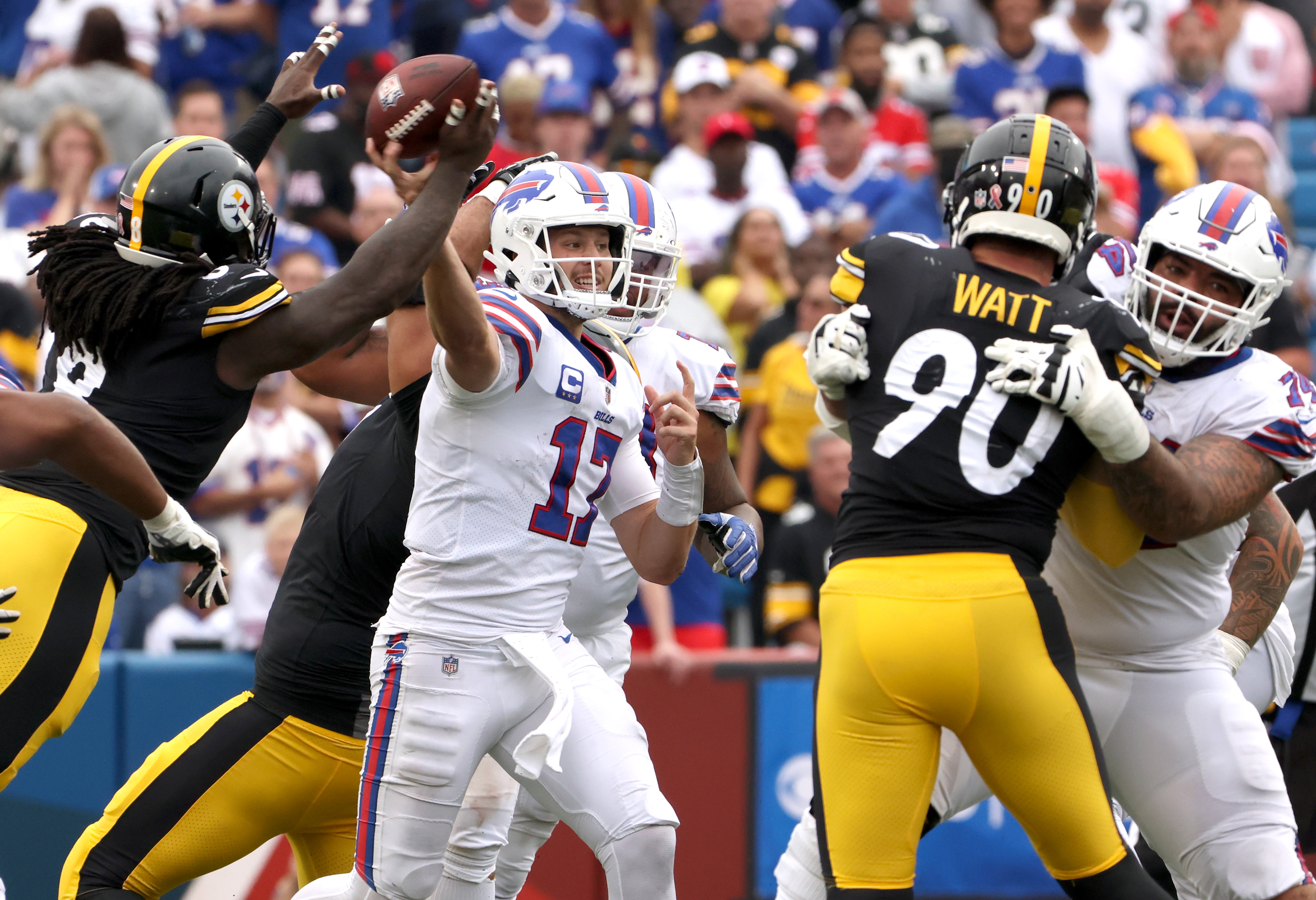Josh Allen #17 of the Buffalo Bills throws a pass around Melvin Ingram #8 of the Pittsburgh Steelers during the fourth quarter at Highmark Stadium on September 12, 2021 in Orchard Park, New York.