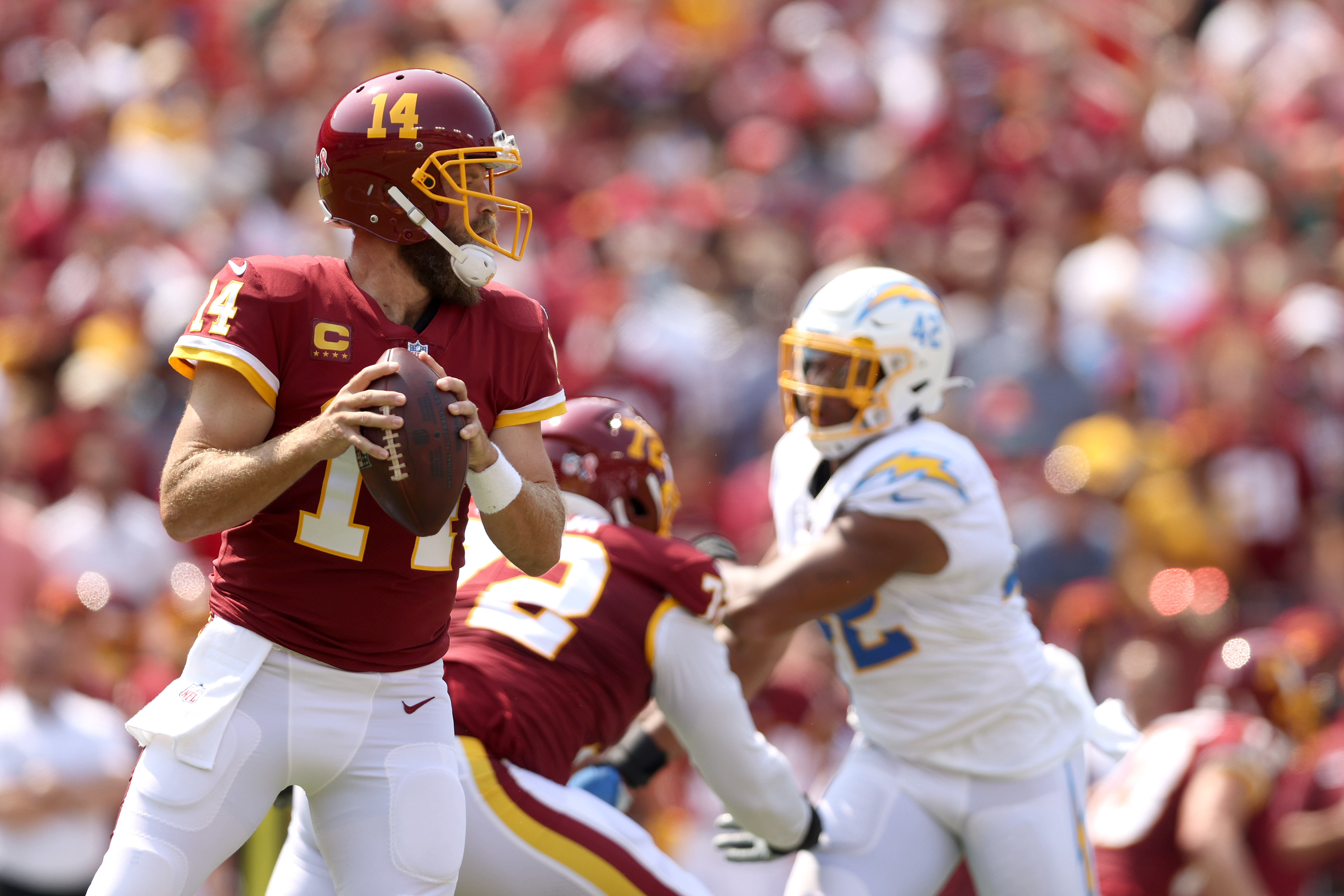 Quarterback Ryan Fitzpatrick #14 of the Washington Football Team throws a pass against the Los Angeles Chargers at FedExField on September 12, 2021 in Landover, Maryland.
