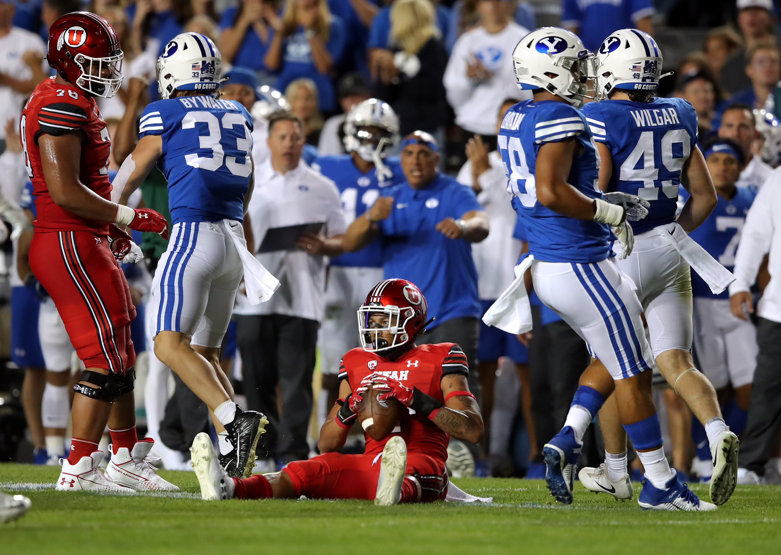 Utah running back Micah Bernard sits up after being tackled during game against BYU at LaVell Edwards Stadium in Provo, Utah.