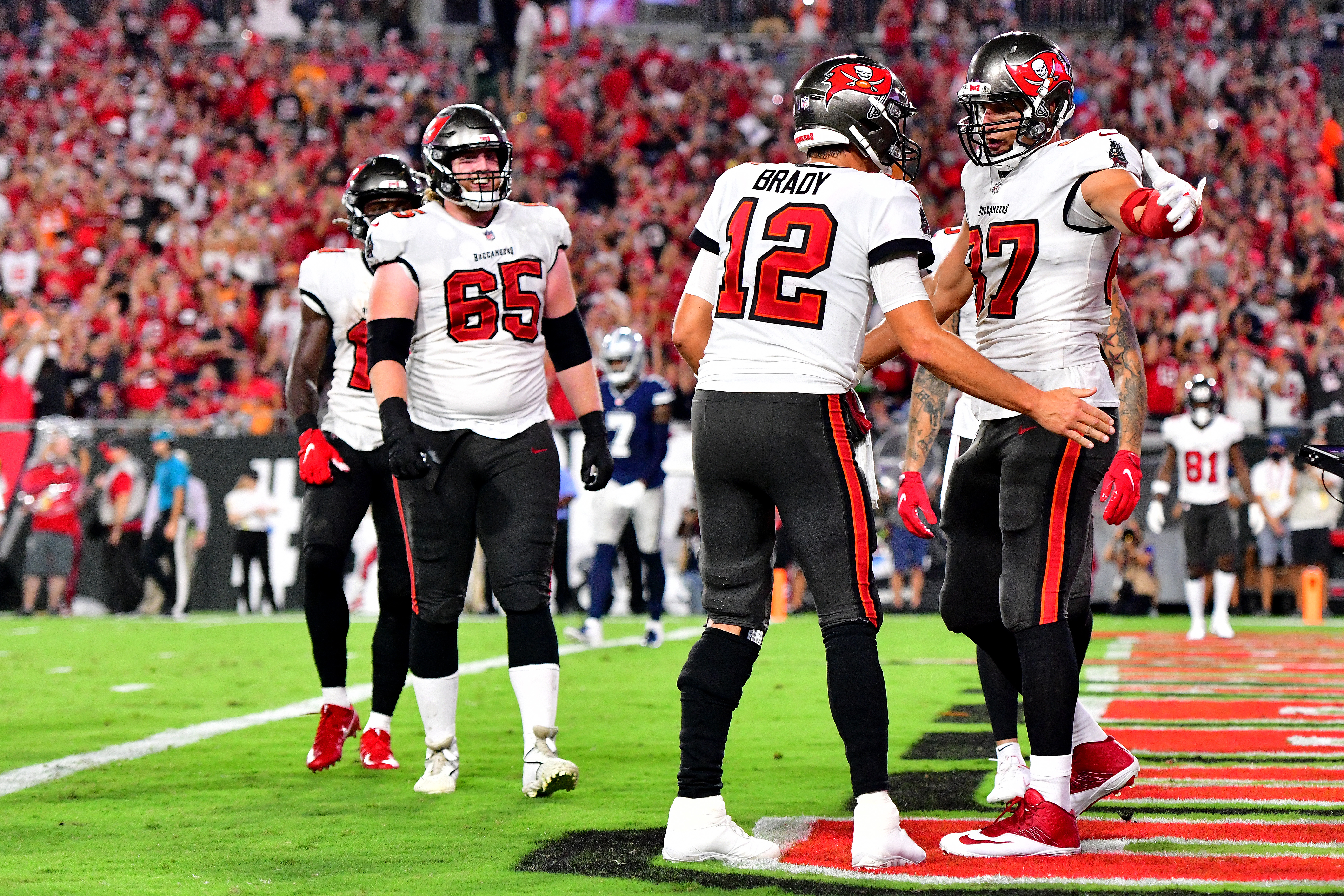 Tom Brady #12 and Rob Gronkowski #87 of the Tampa Bay Buccaneers celebrate a touchdown during the second quarter against the Dallas Cowboys at Raymond James Stadium on September 09, 2021 in Tampa, Florida.