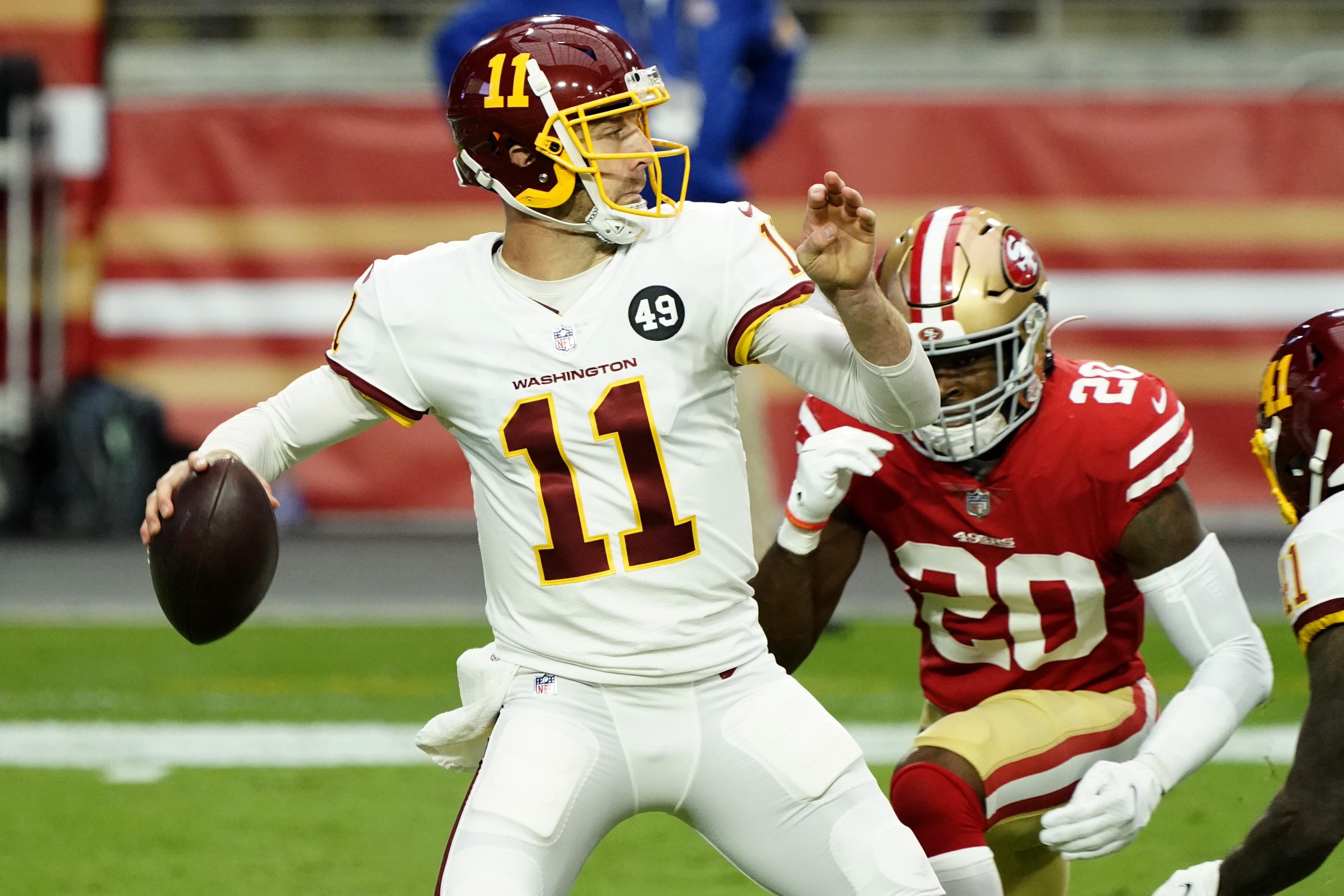 Washington Football Team quarterback Alex Smith  throws the ball during an NFL game.