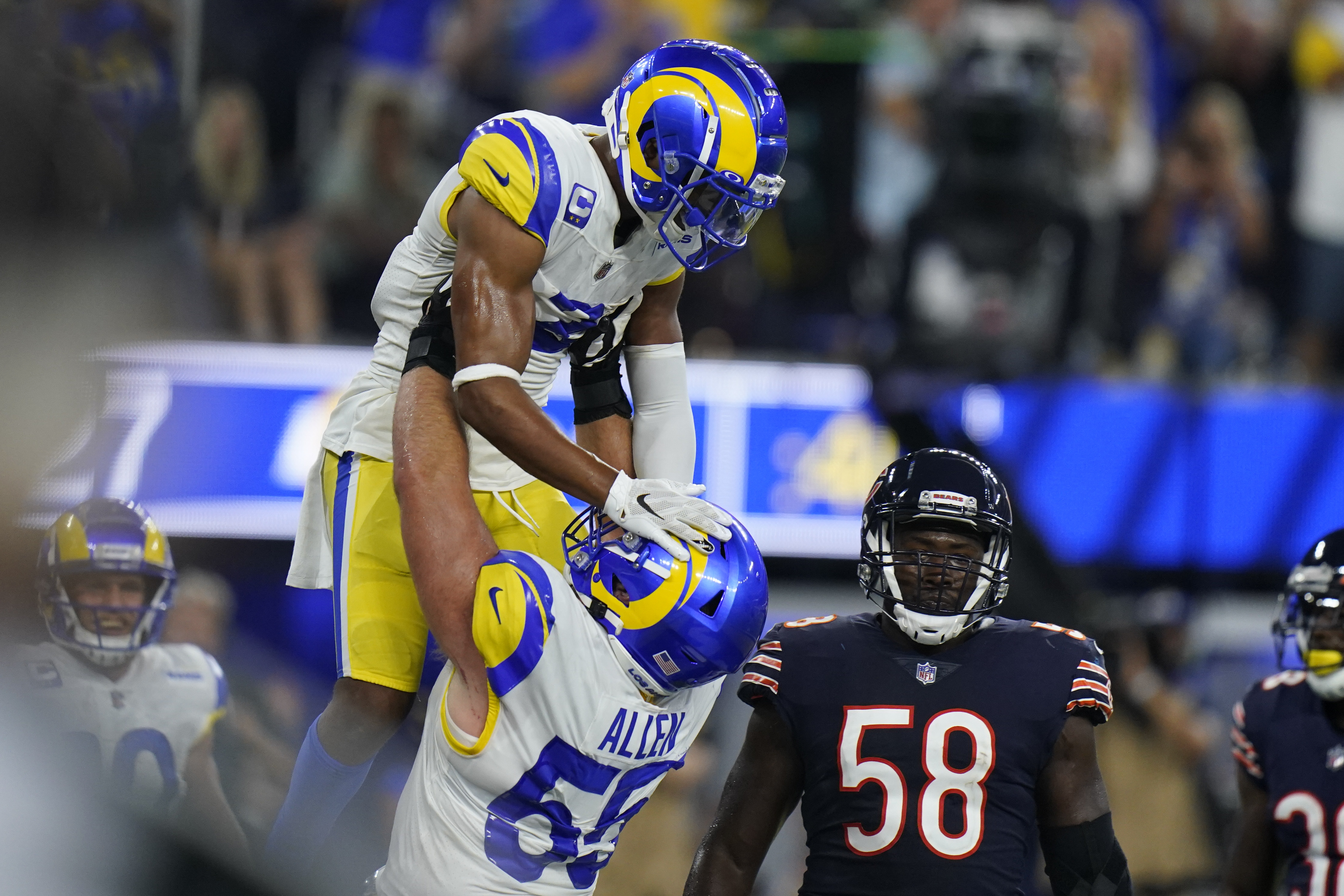 The Rams celebrate a touchdown in front of linebacker Roquan Smith on Sunday.