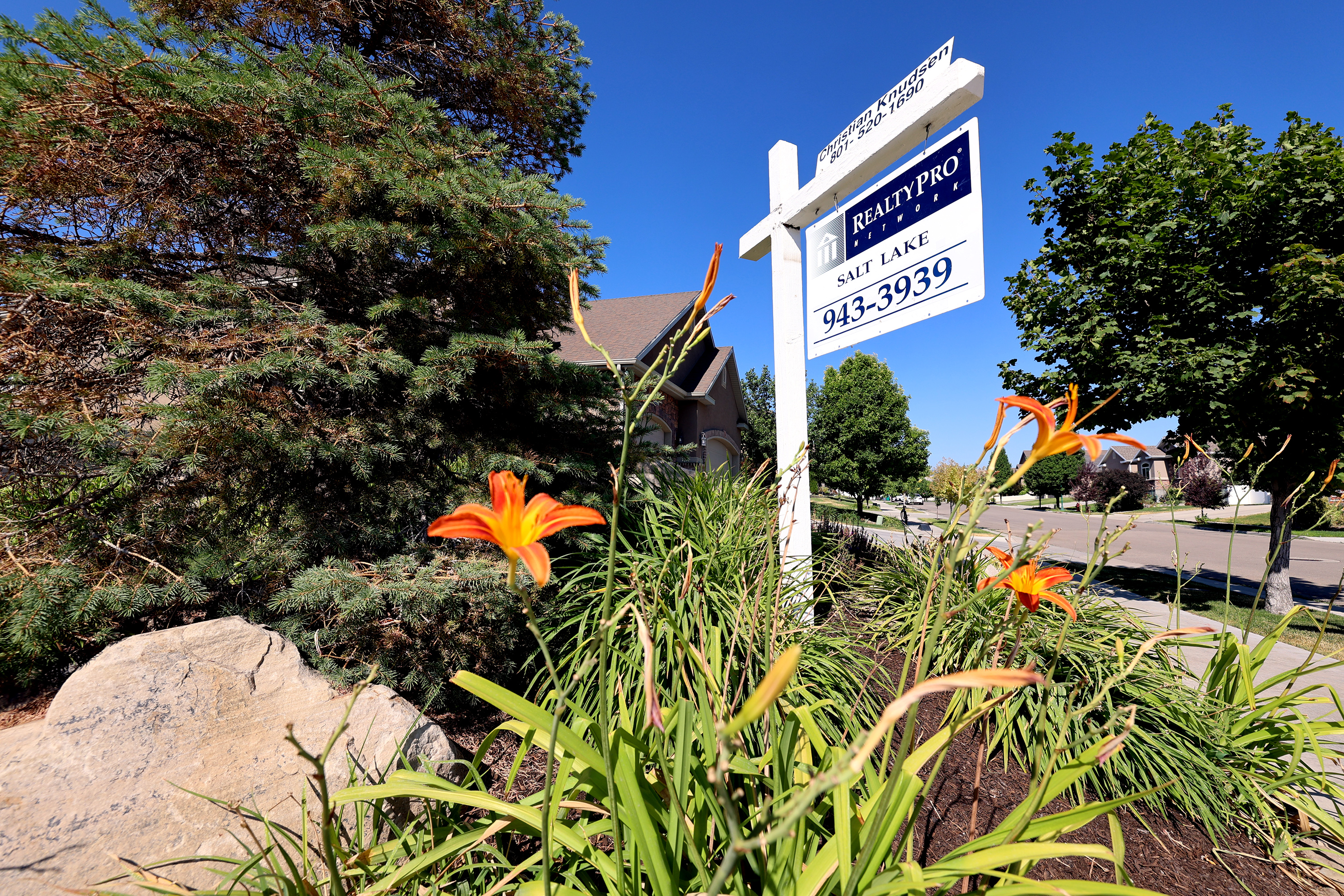 A home for sale sign in the Salt Lake Valley.