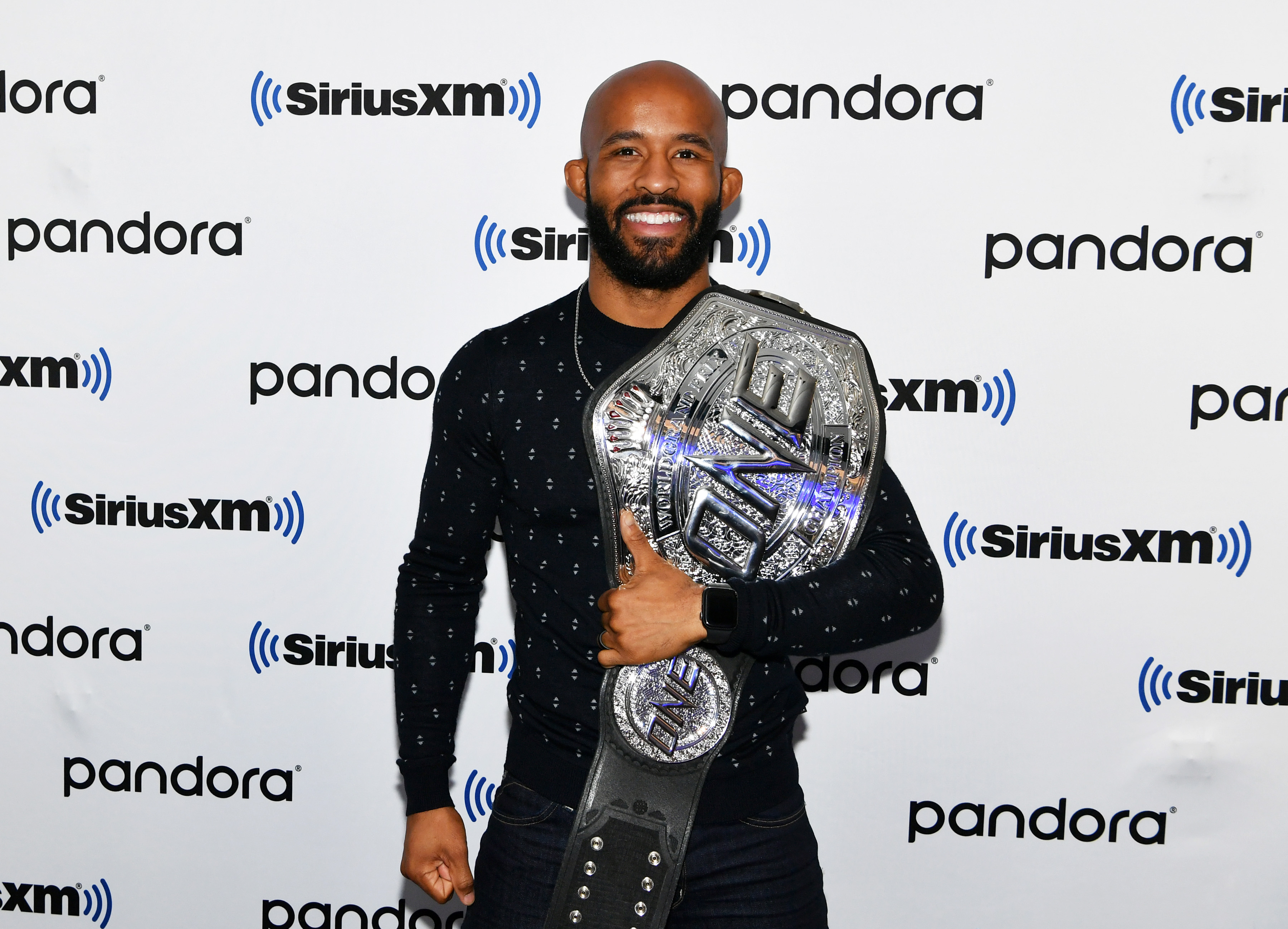 Demetrious Johnson poses with the ONE Championship belt.