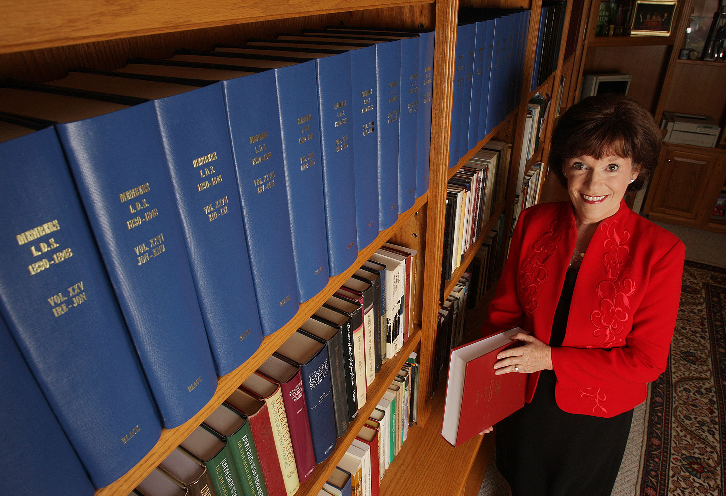 Author Susan Easton Black standing next to a bookshelf in her home in Provo, Utah.