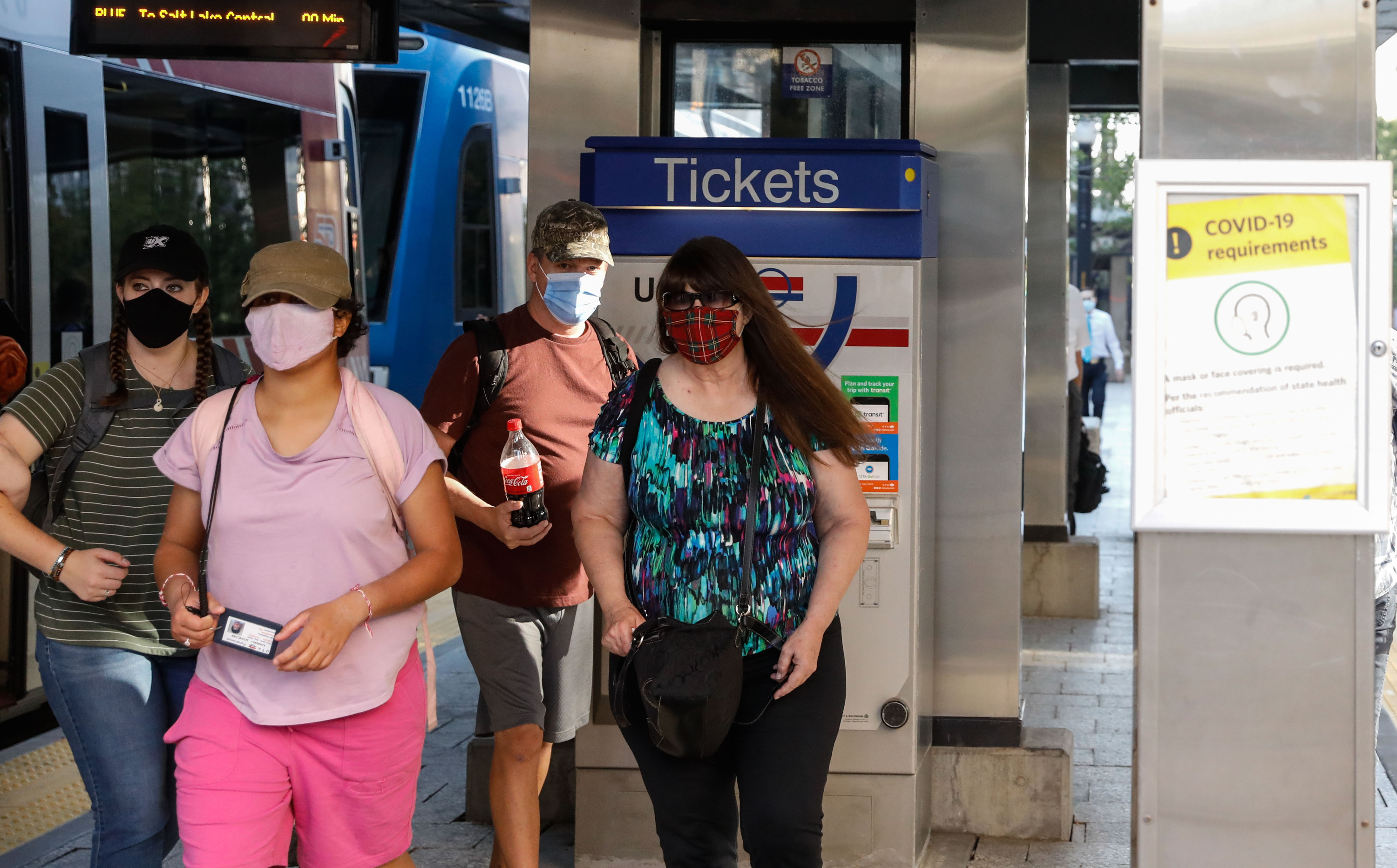 Utah Transit Authority riders wearing masks navigate the TRAX platform at the City Center Station in Salt Lake City on Wednesday, Sept. 15, 2021.