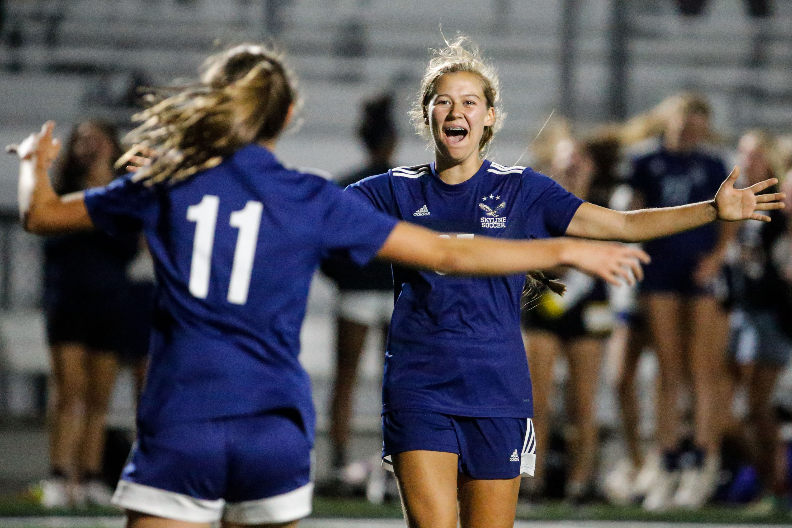Skyline's Lily Hall, right, and Lily Boyden celebrate the team's third goal duringa high school girls soccer game at Skyline High School in Salt Lake City on Thursday, Sept. 16, 2021.
