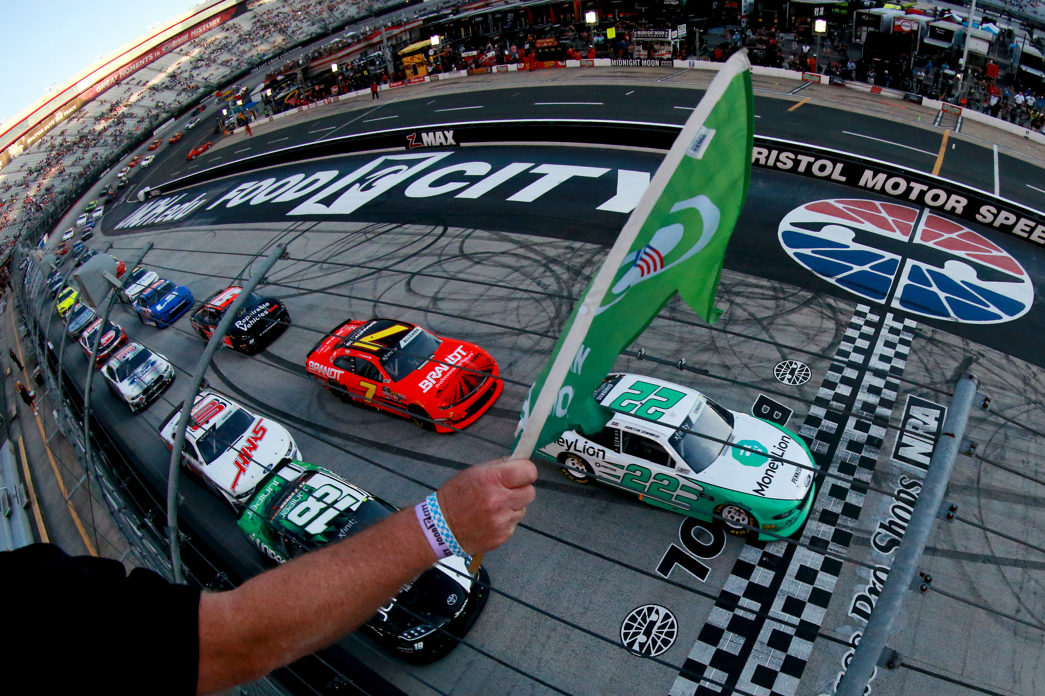 Austin Cindric, driver of the #22 MoneyLion Ford, leads the field to the green flag to start the NASCAR Xfinity Series Food City 300 at Bristol Motor Speedway on August 16, 2019 in Bristol, Tennessee.