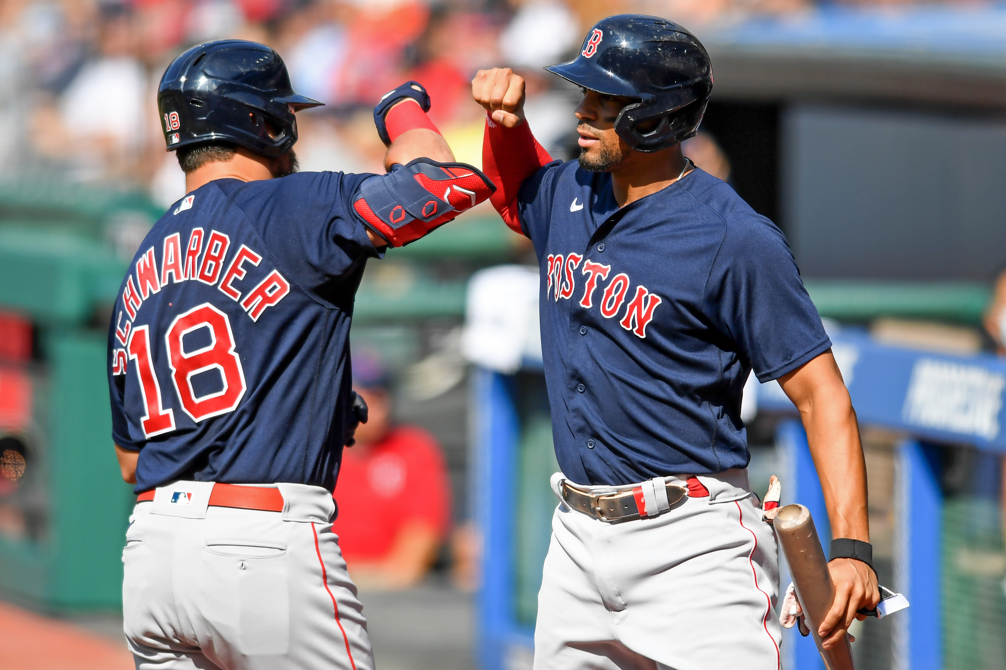 Kyle Schwarber and Xander Bogaerts of the Boston Red Sox celebrate after a solo home run by Schwarber off Cal Quantrill of the Cleveland Indians in the first inning at Progressive Field on August 28, 2021 in Cleveland, Ohio.