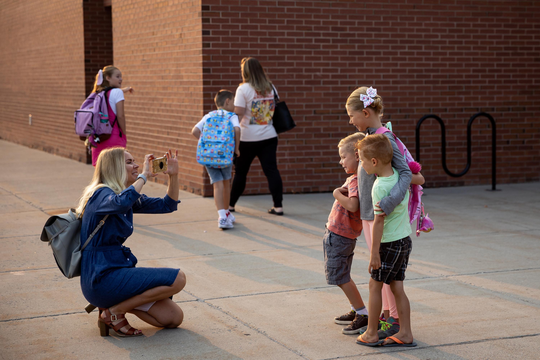 Kristen Romero takes a photo of her children at Altara Elementary in Sandy.