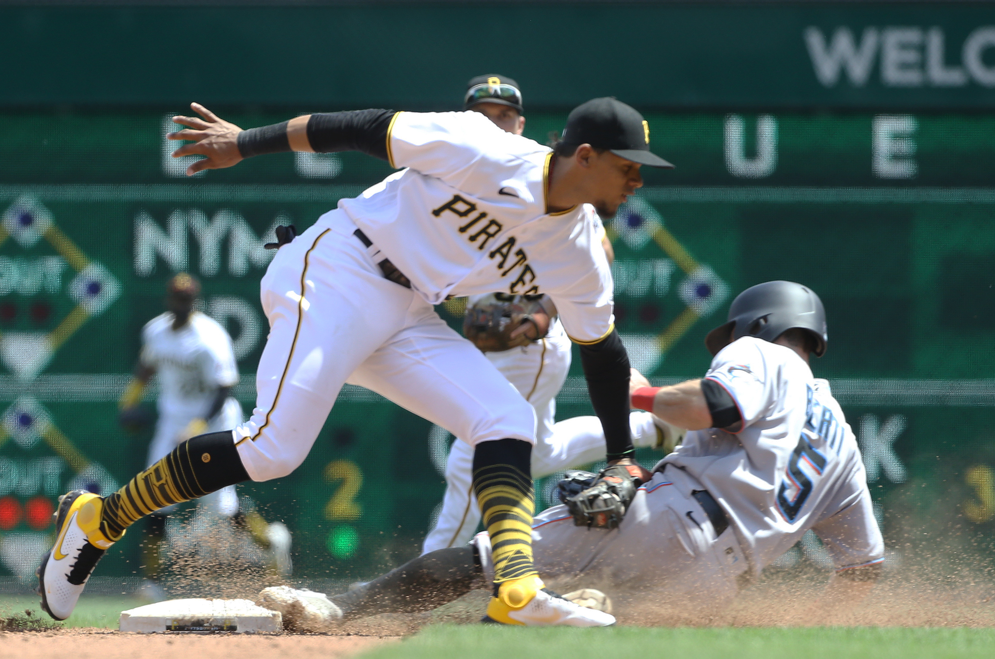 Pittsburgh Pirates shortstop Erik Gonzalez (2) tags Miami Marlins second baseman Jon Berti (5) out at second base on a steal attempt during the sixth inning at PNC Park.