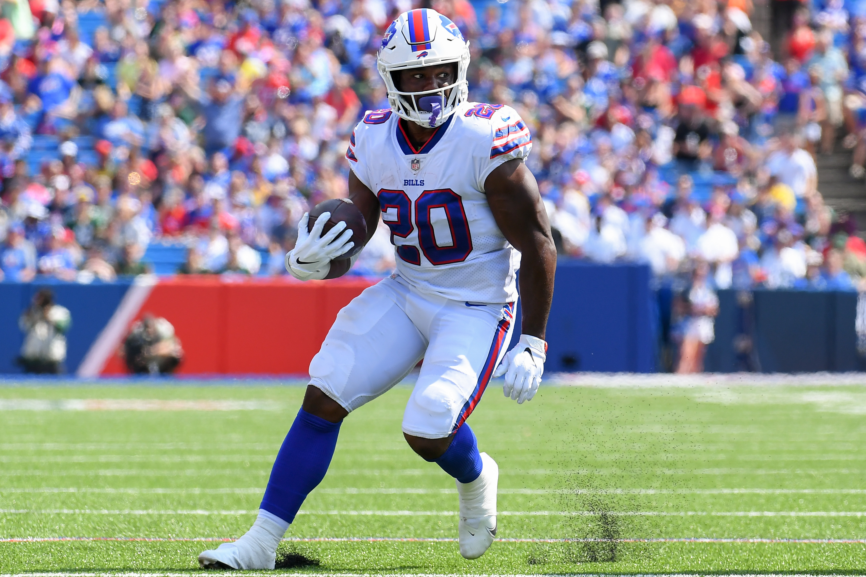 Buffalo Bills running back Zack Moss (20) runs with the ball against the Green Bay Packers during the first half at Highmark Stadium.