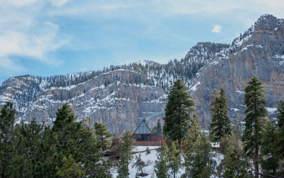 An A-frame lodge in the mountains.