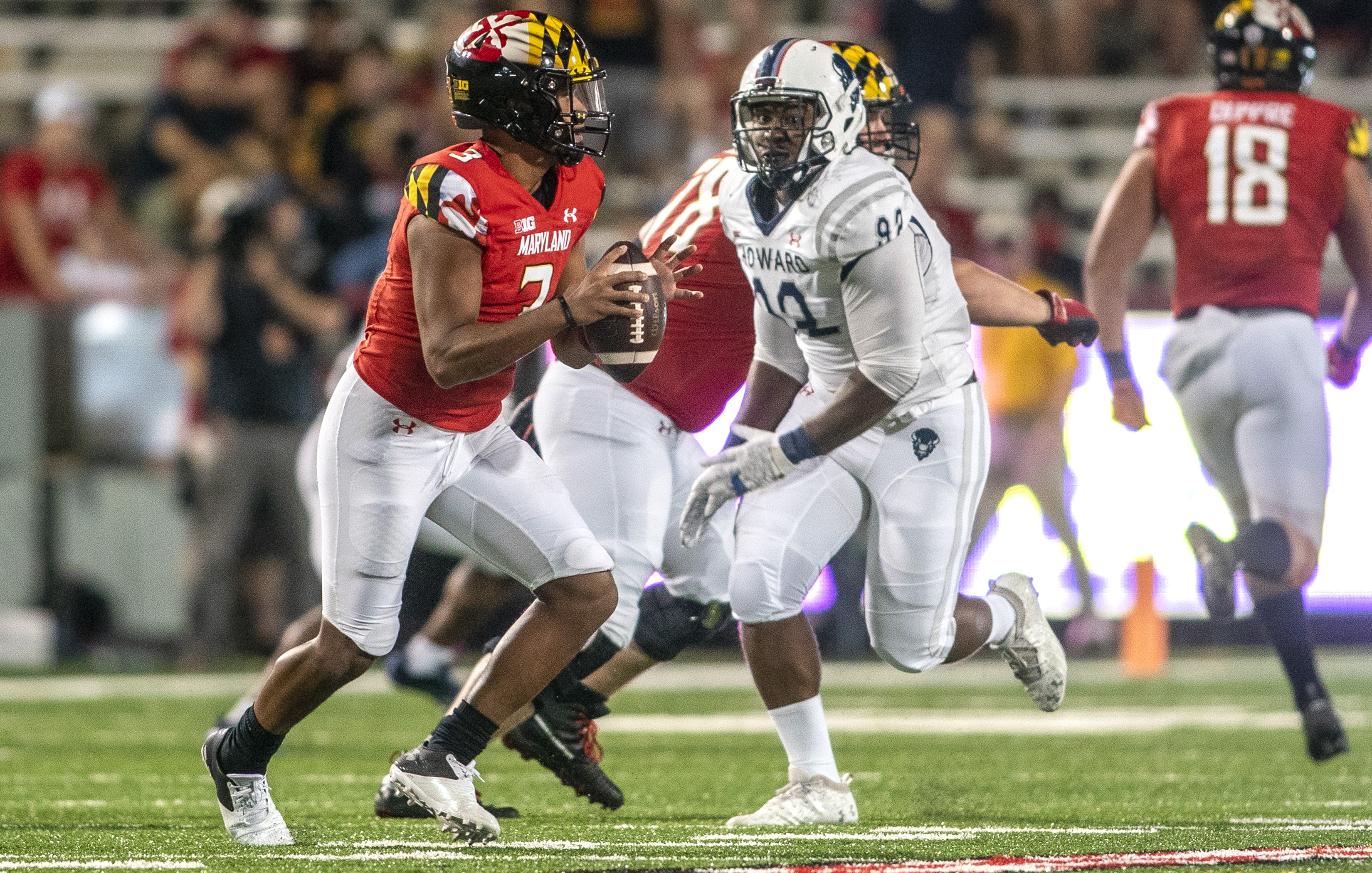 Howard Bison defensive lineman Aaron Motley moves up on Maryland Terrapins quarterback Taulia Tagovailoa during a college football game between the Howard Bison and the Maryland Terrapins, on September 11, 2021, at Capital One Field at Maryland Stadium, in College Park, Maryland.