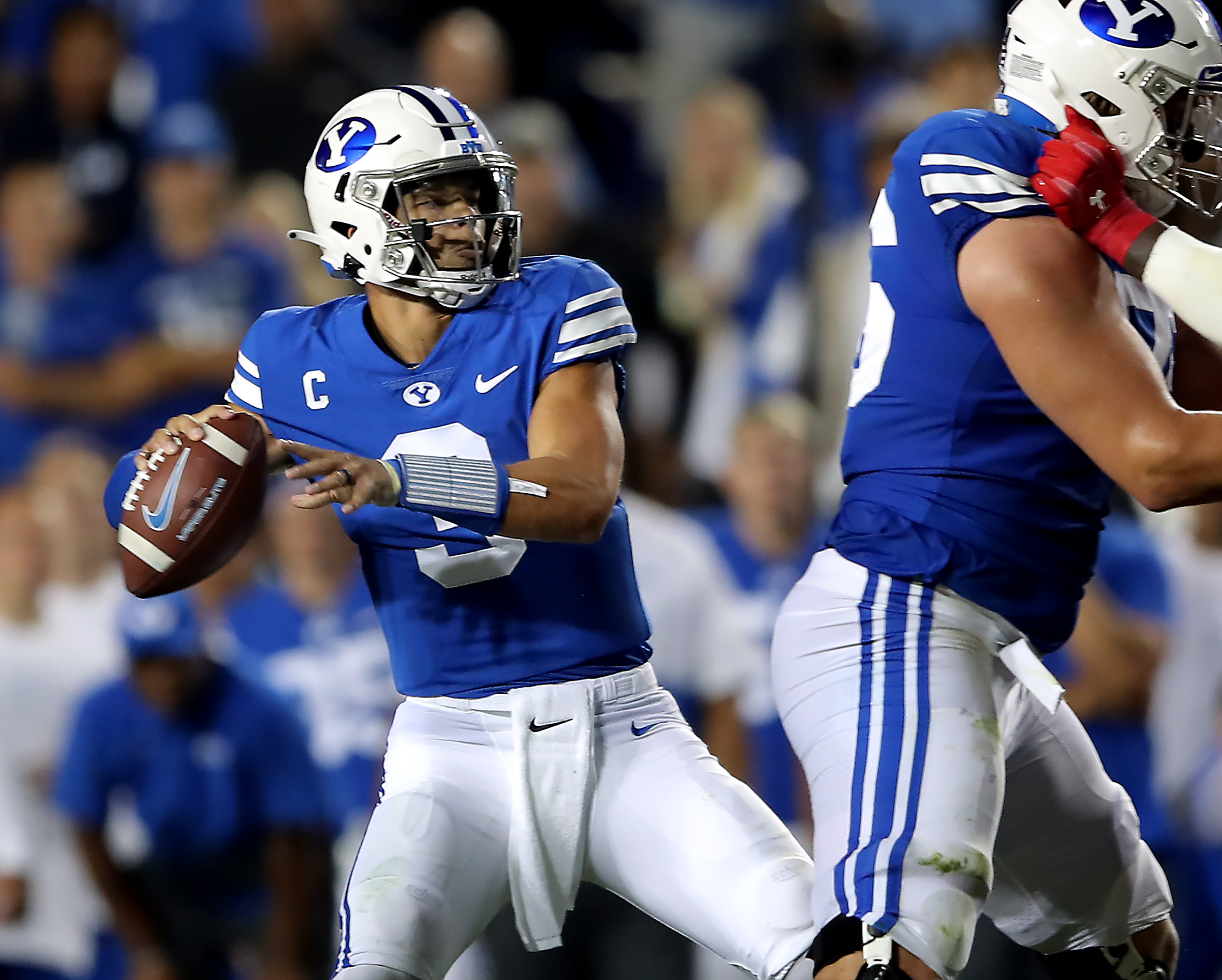 Brigham Young Cougars quarterback Jaren Hall delivers a pass as BYU and Utah play.