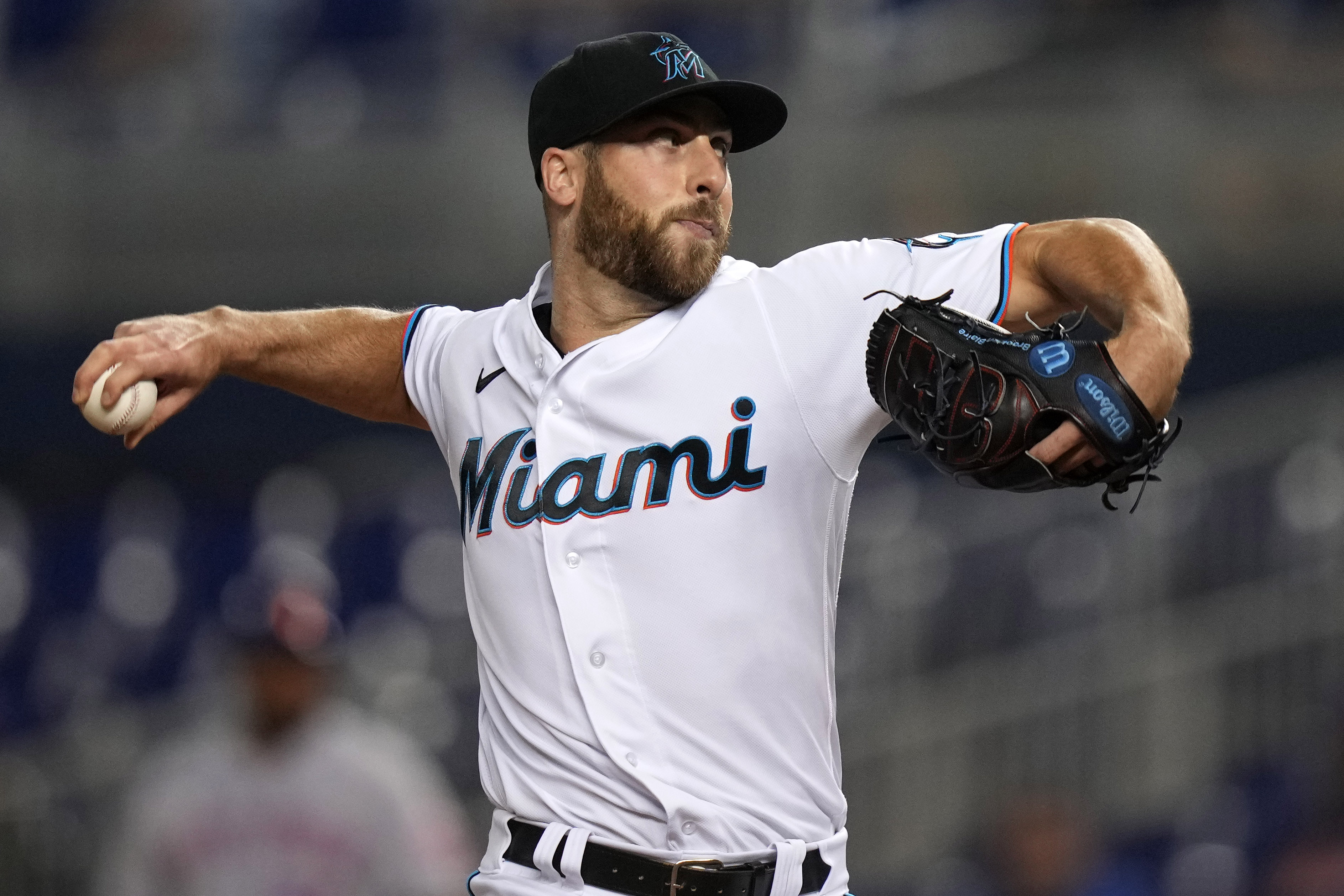 Miami Marlins relief pitcher Anthony Bass (52) delivers a pitch in the 7th inning against the New York Mets at loanDepot park