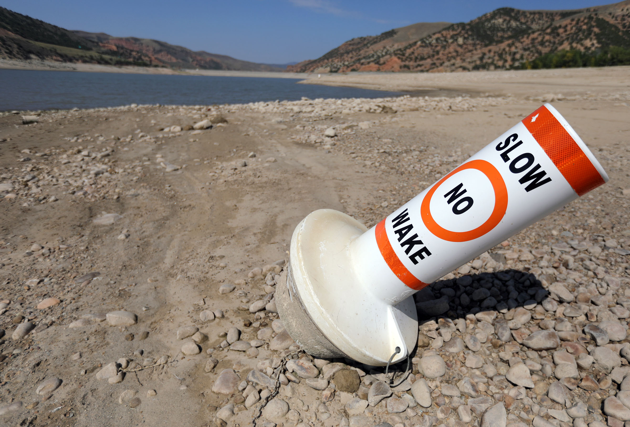 A marker buoy is grounded on the dried-up shore of Echo Reservoir, which is currently at 12% capacity, at Echo State Park during a drought on Thursday, Sept. 16, 2021. Utah may be headed into fall with cooler temperatures and less pressure to water, but the emergency drought situation is by no means over.
