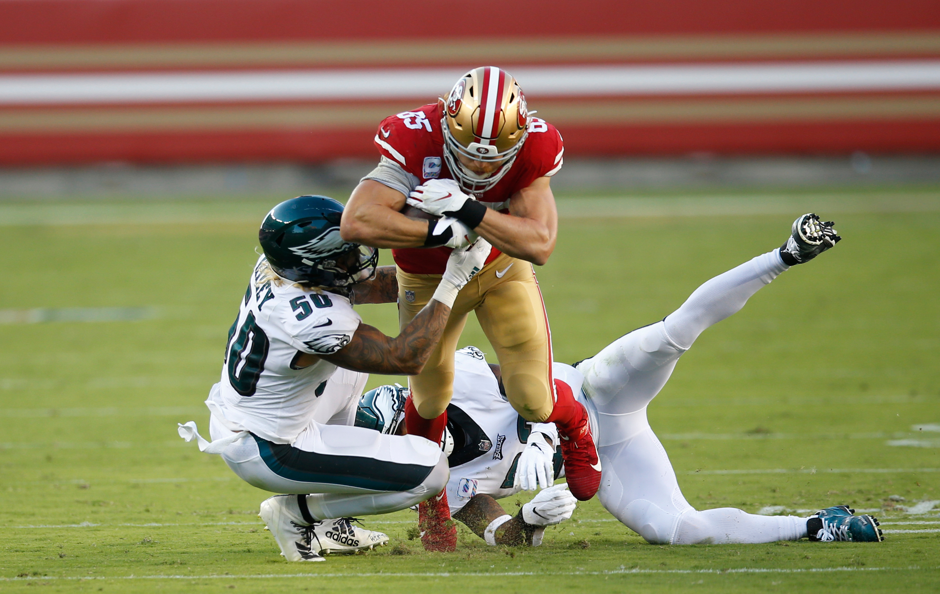 George Kittle #85 of the San Francisco 49ers runs after making a catch during the game against the Philadelphia Eagles at Levi's Stadium on October 4, 2020 in Santa Clara, California.