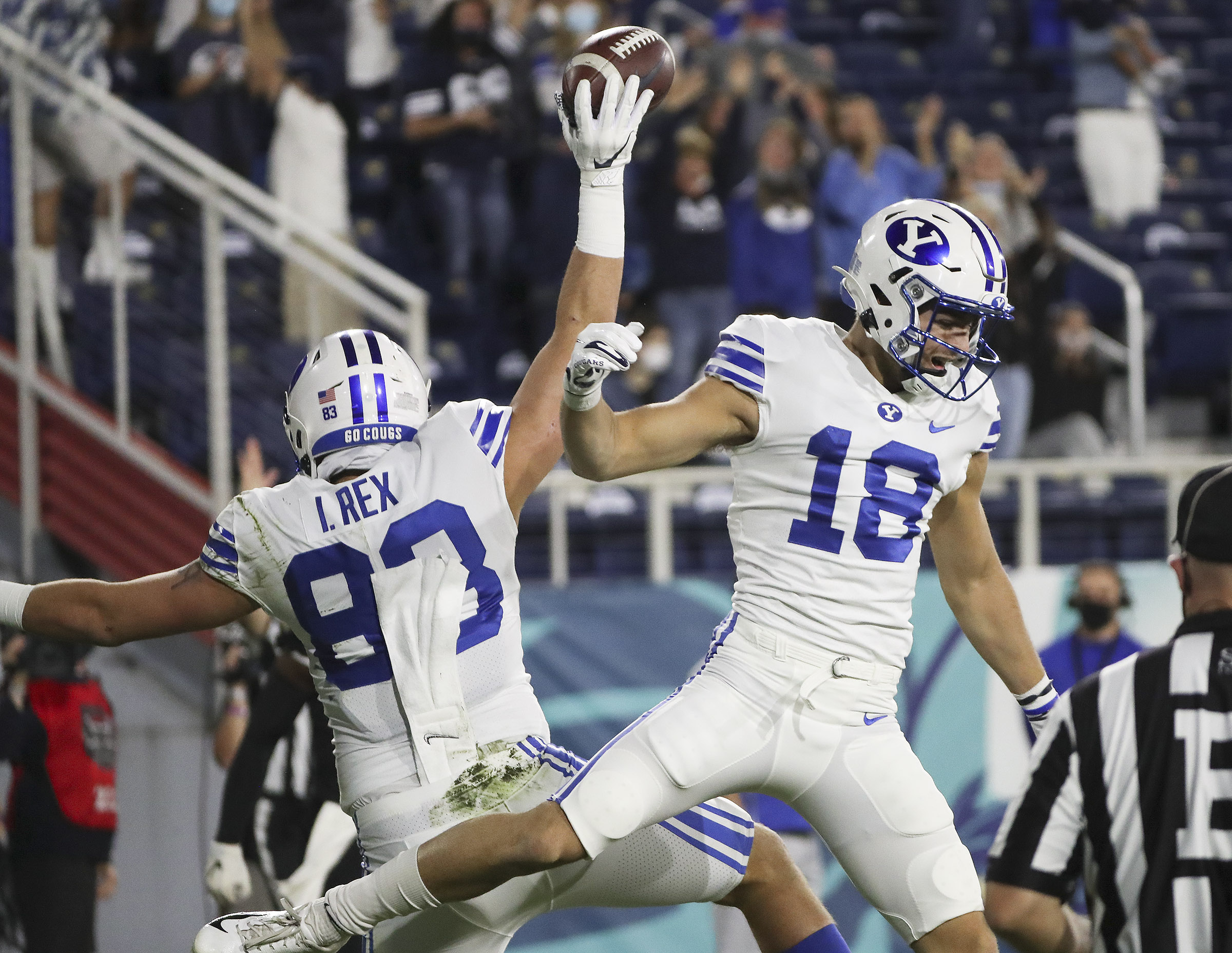 BYU tight end Isaac Rex celebrates his touchdown with BYU wide receiver Gunner Romney in Boca Raton, Florida.