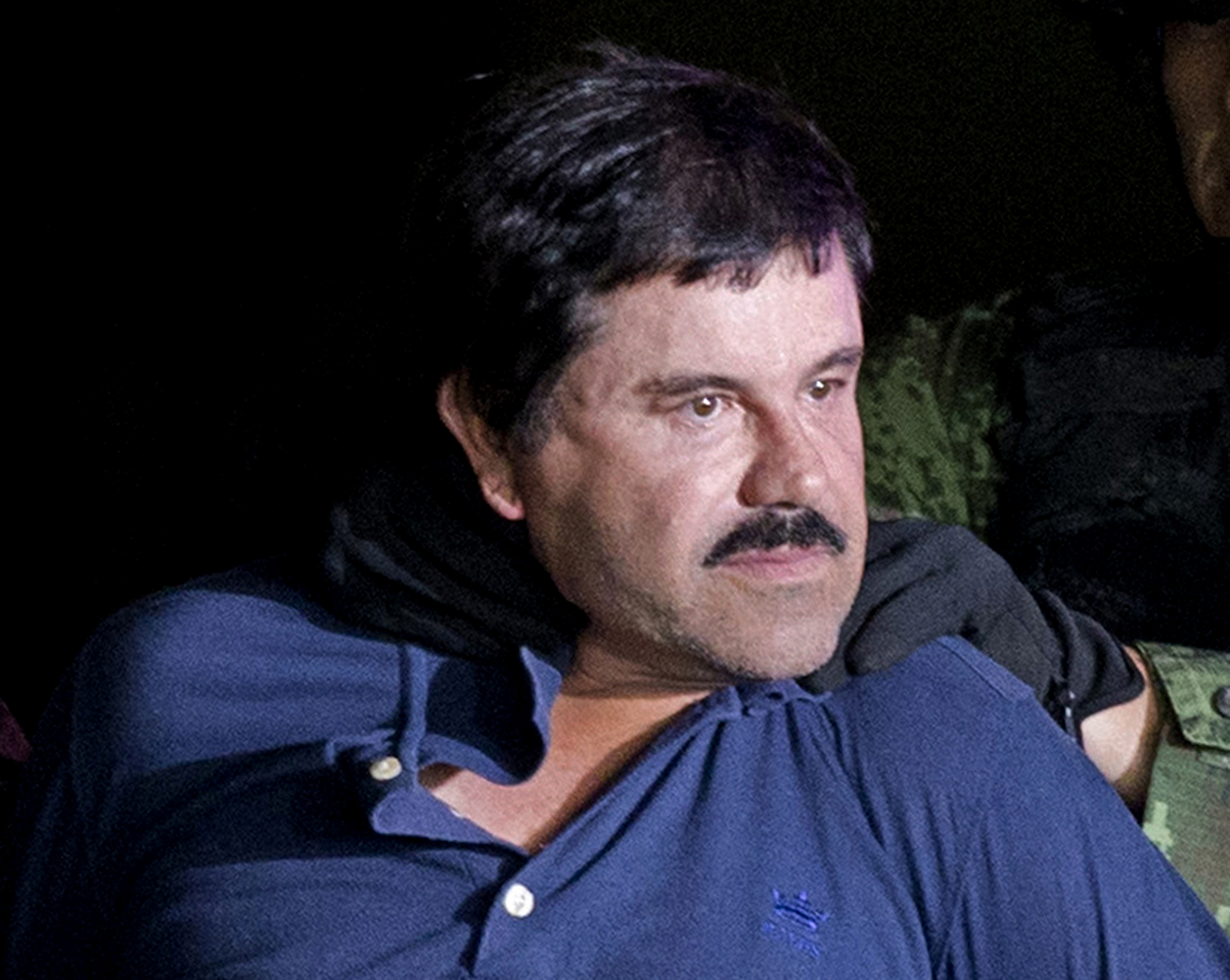 """Drug lord Joaquin """"El Chapo"""" Guzmán Loera in January 2016 in Mexico City as he was escorted by Mexican soldiers following his recapture."""
