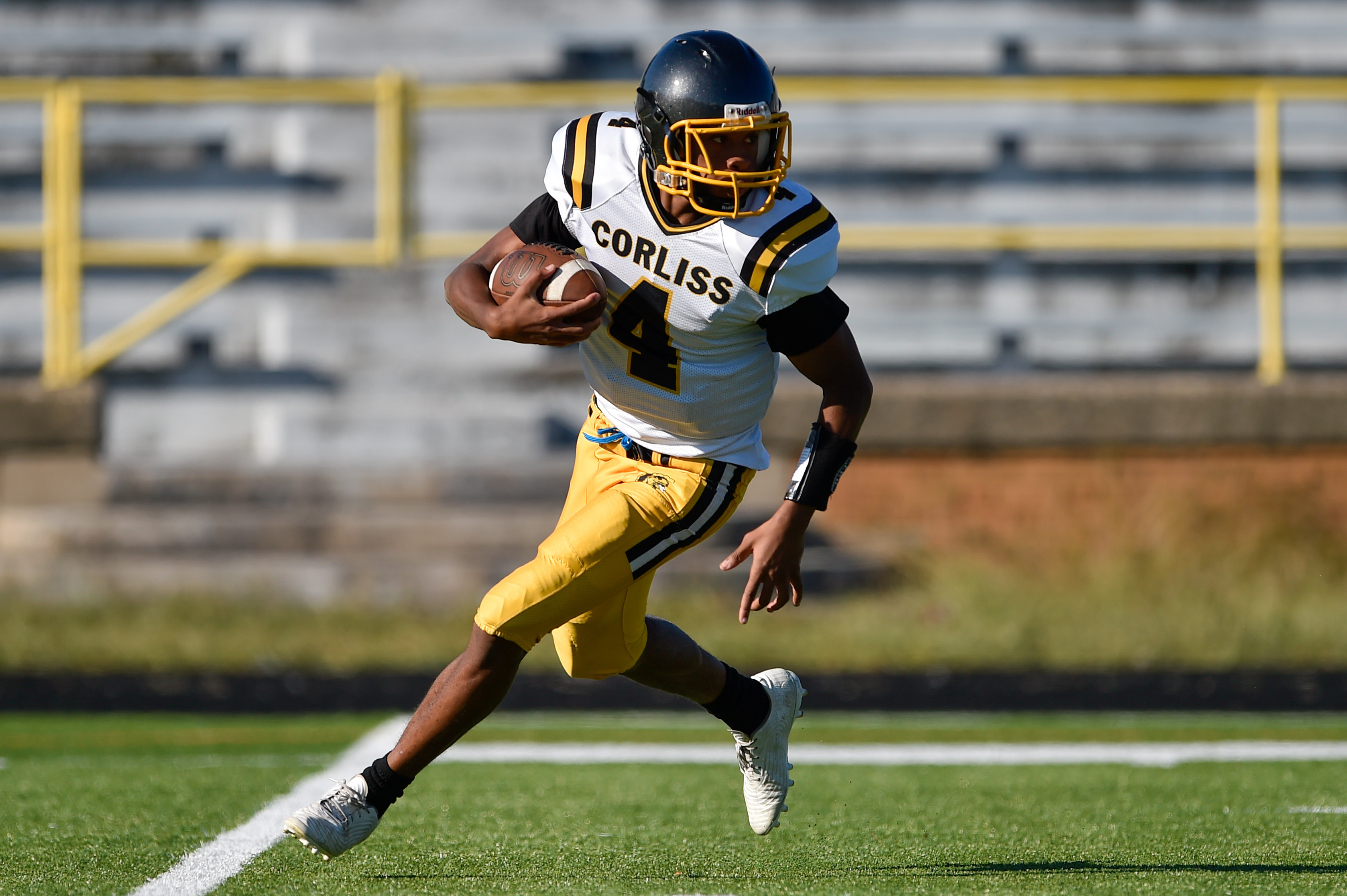 Corliss' Malachi McCLure (4) runs the ball during the game against South Shore.
