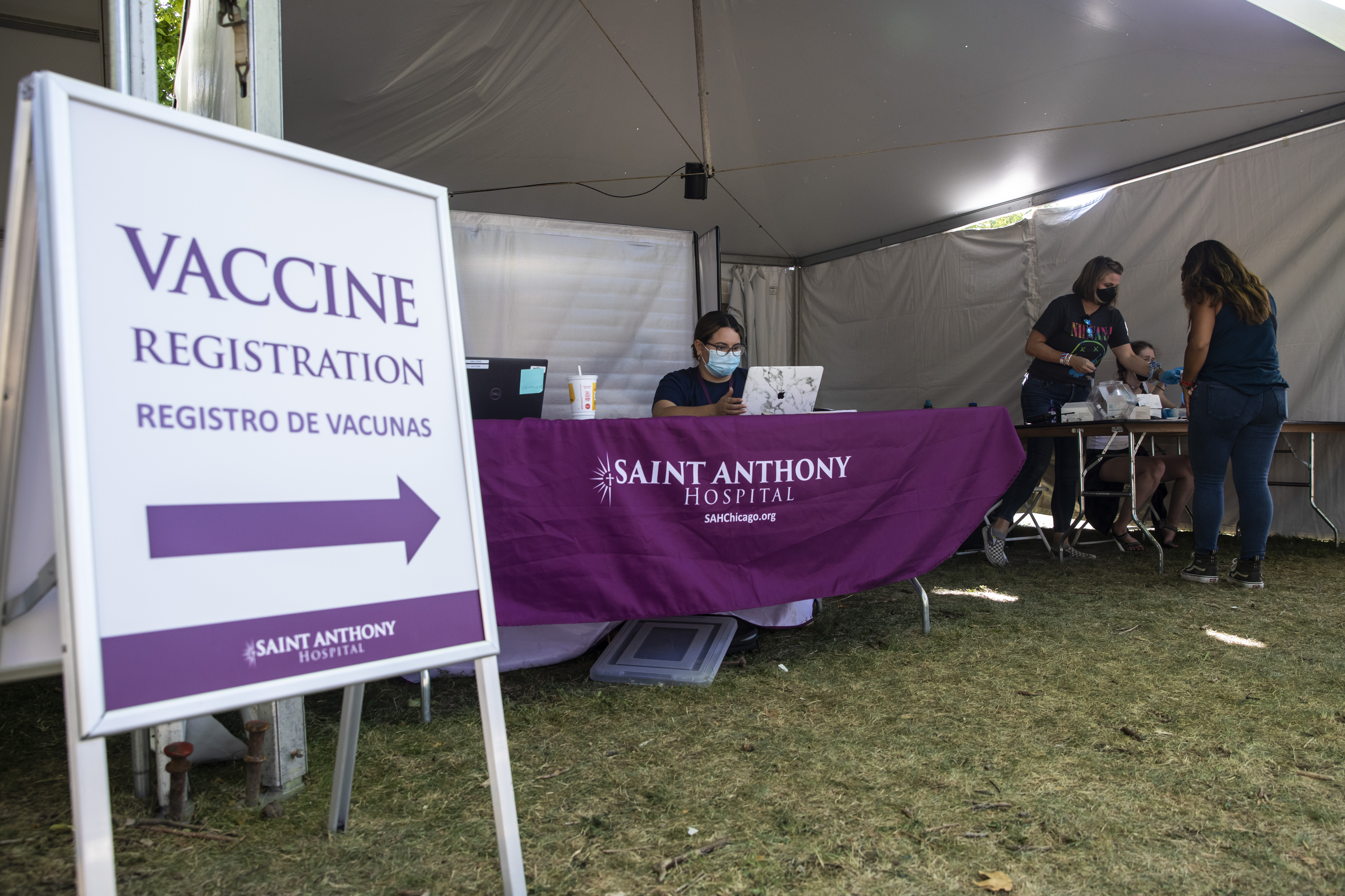 Saint Anthony Hospital offers both the Pfizer and J&J COVID-19 vaccines at the entrance to Riot Fest in Douglass Park. About 61% of Illinoisans 12 or older are fully vaccinated.