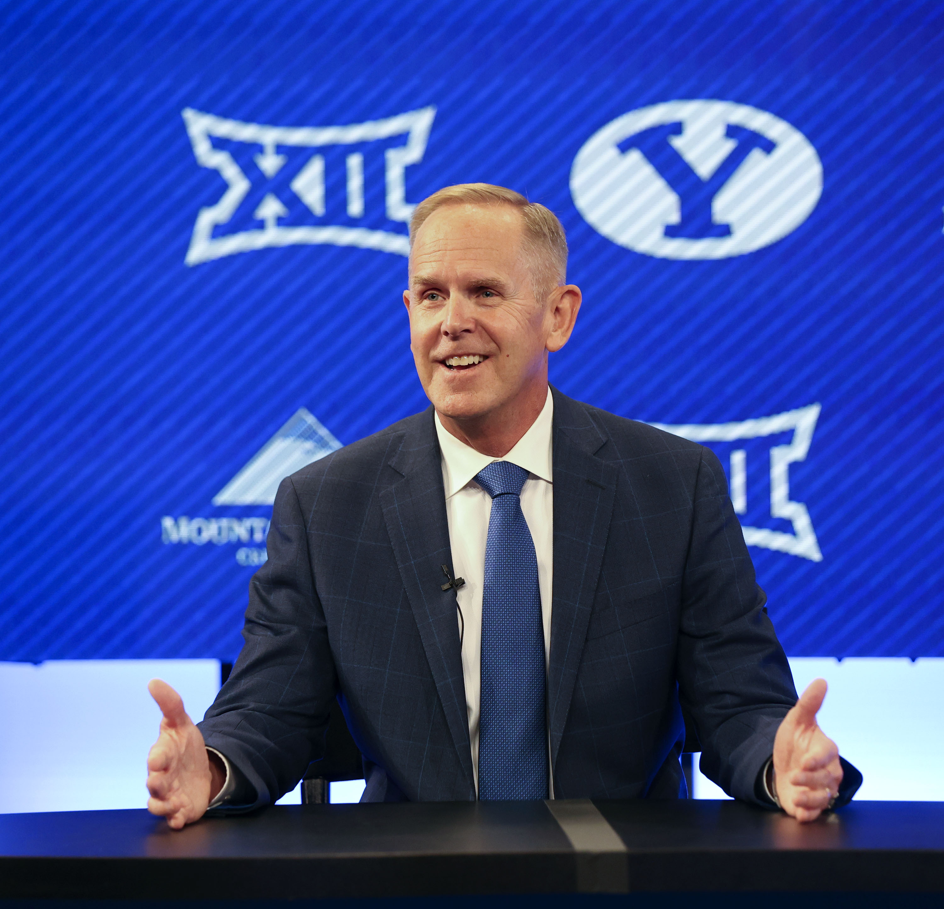 BYU athletic director Tom Holmoe speaks at a press conference announcing that BYU has accepted an invitation to the Big 12 Conference at BYU in Provo on Friday, Sept. 10, 2021. BYU will play all sports provided by the Big 12 except for equestrian, rowing and wrestling. Men's volleyball will continue to play in the Mountain Pacific Sports Federation, as the Big 12 does not offer the sport.