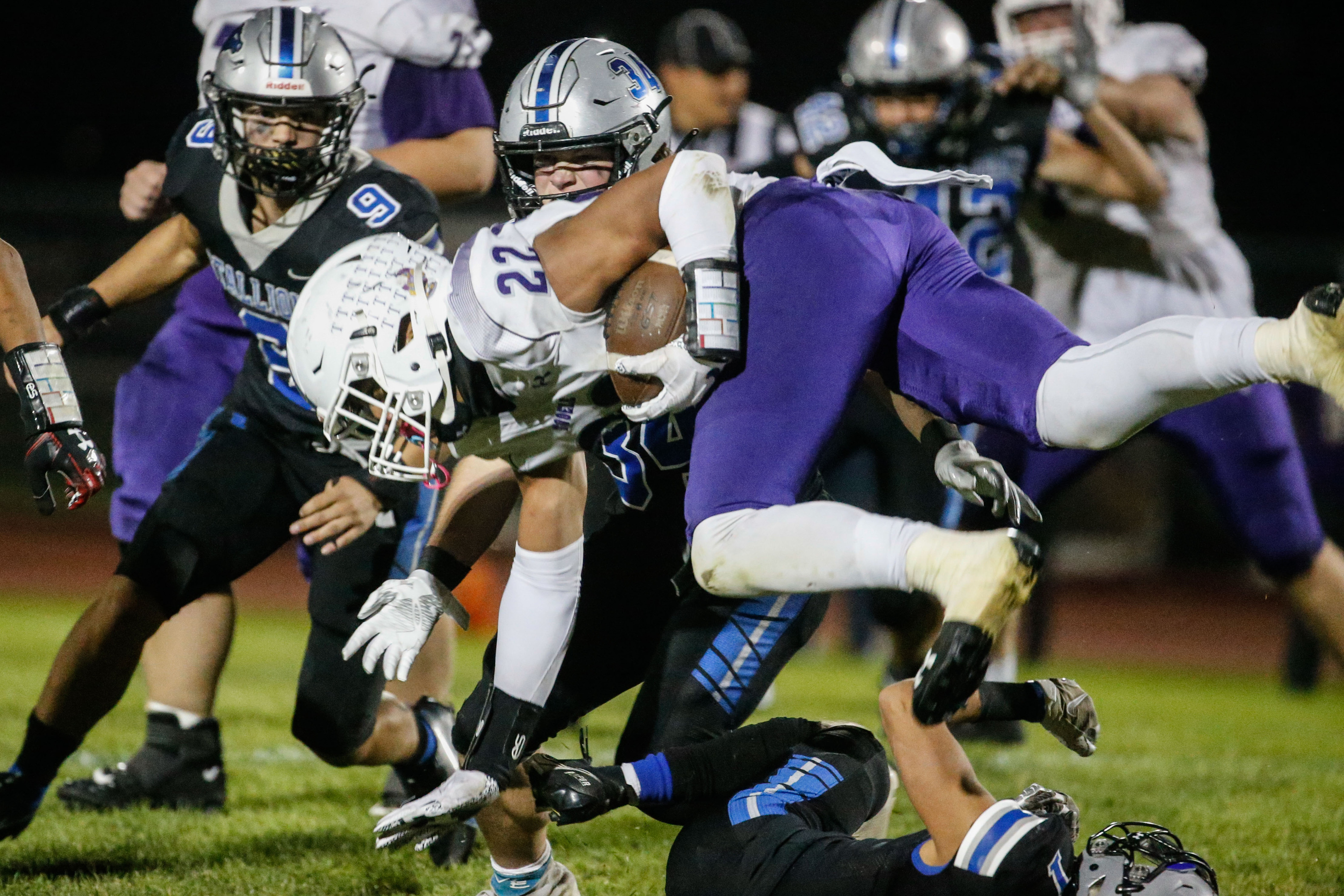 Tooele's Mapa Vaenuku (22) dives while getting pressured by Stansbury's defense during a high school football gameat Stansbury High School in Stansbury Park on Friday, Sept. 17, 2021.