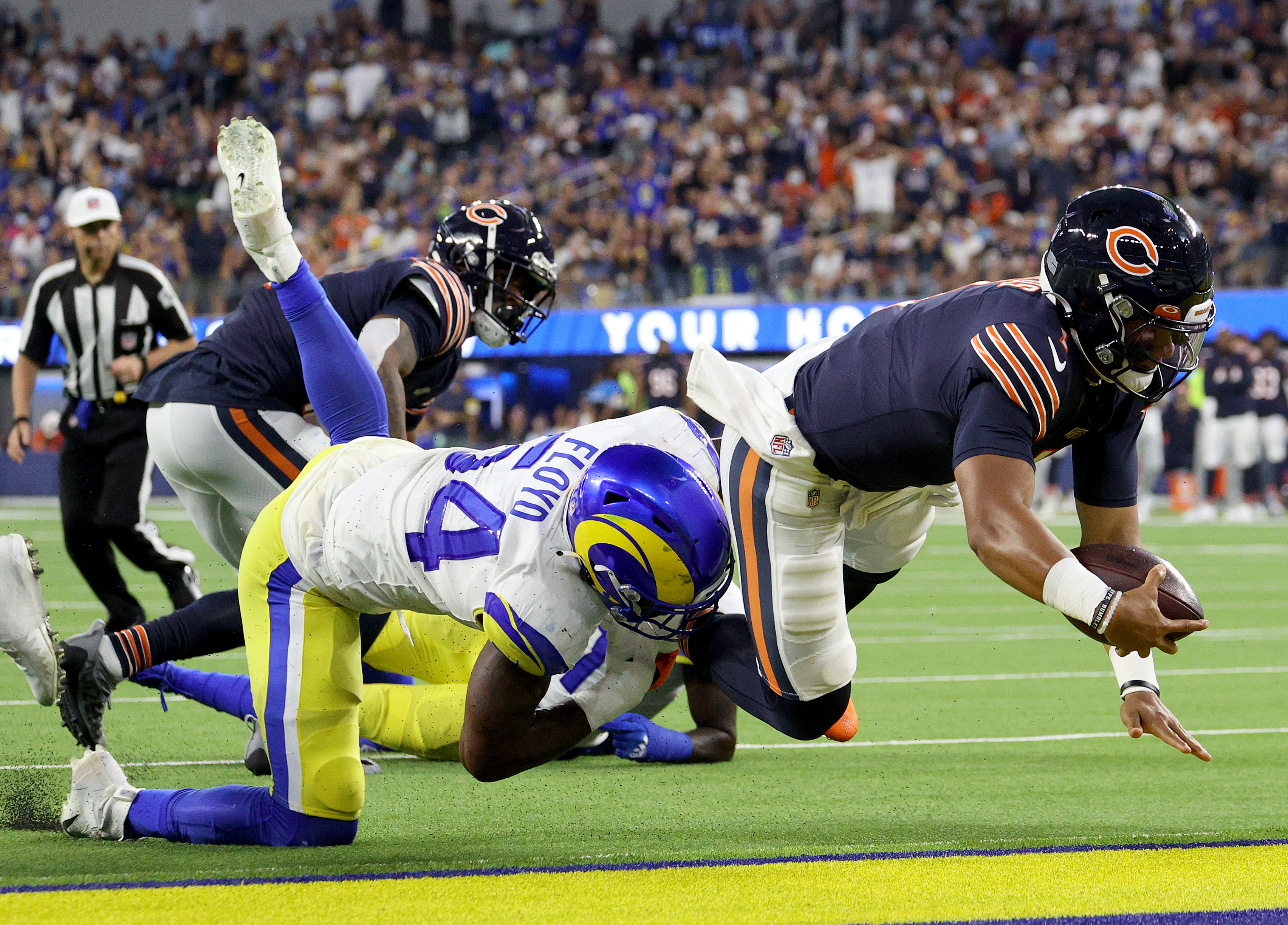 Bears quarterback Justin Fields scores against the Rams on Sunday.