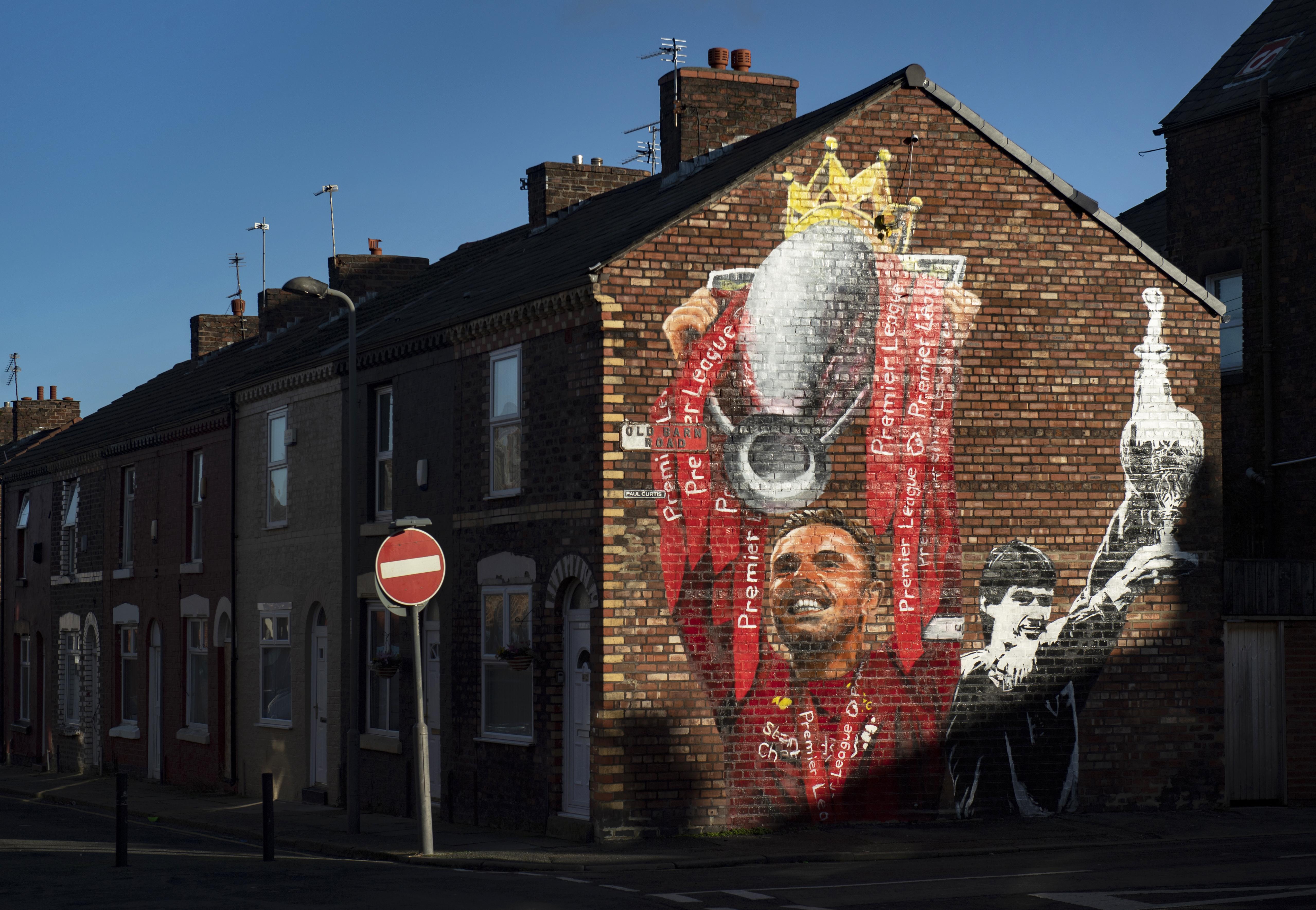 A Mural of Liverpool Captain Jordan Henderson Lifting the Premier League Trophy