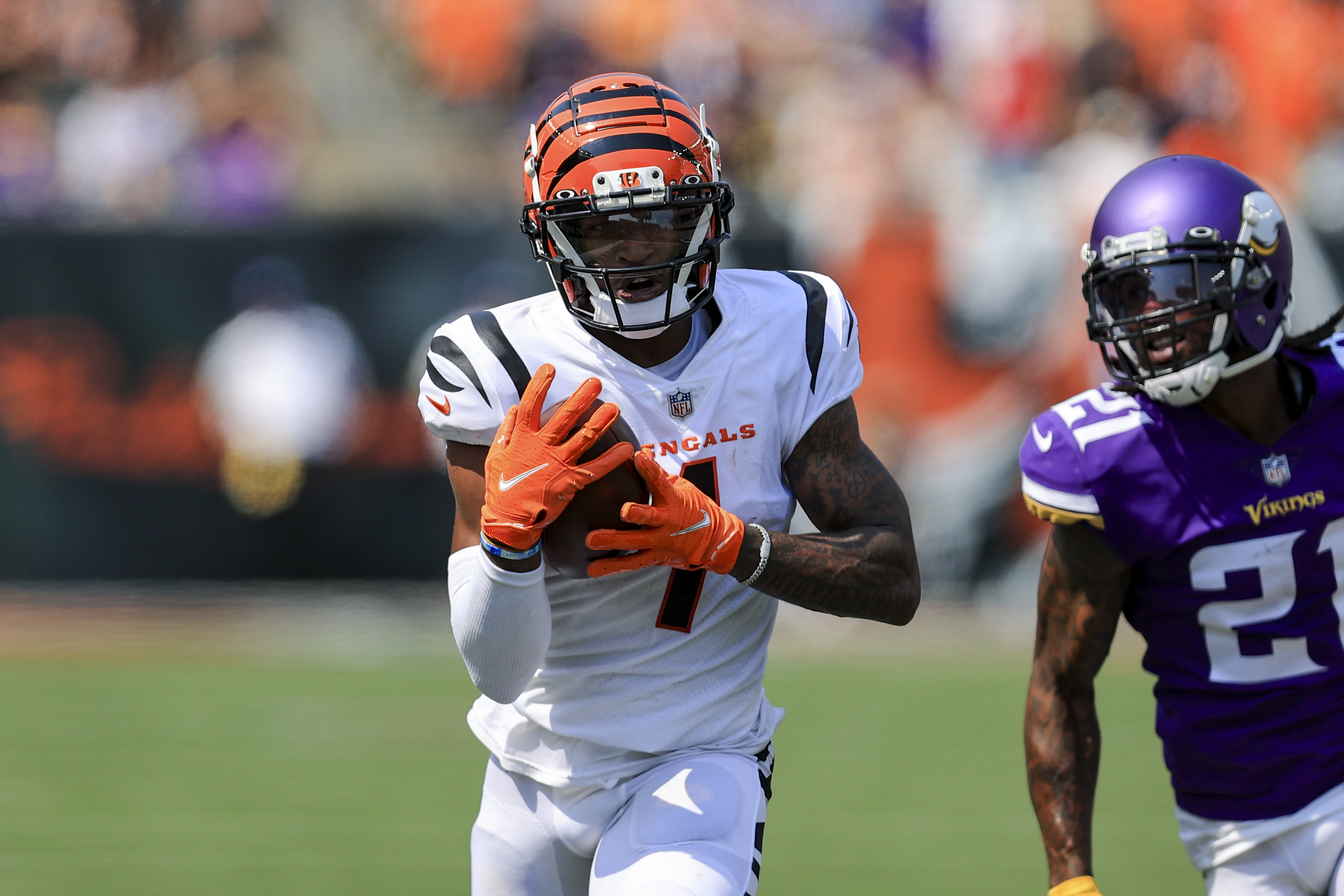 Bengals rookie wide receiver Ja'Marr Chase (1) hauls in a 50-yard touchdown pass from Joe Burrow in the Bengals' 27-24 overtime victory against the Vikings last Sunday at Paul Brown Stadium in Cincinnati.