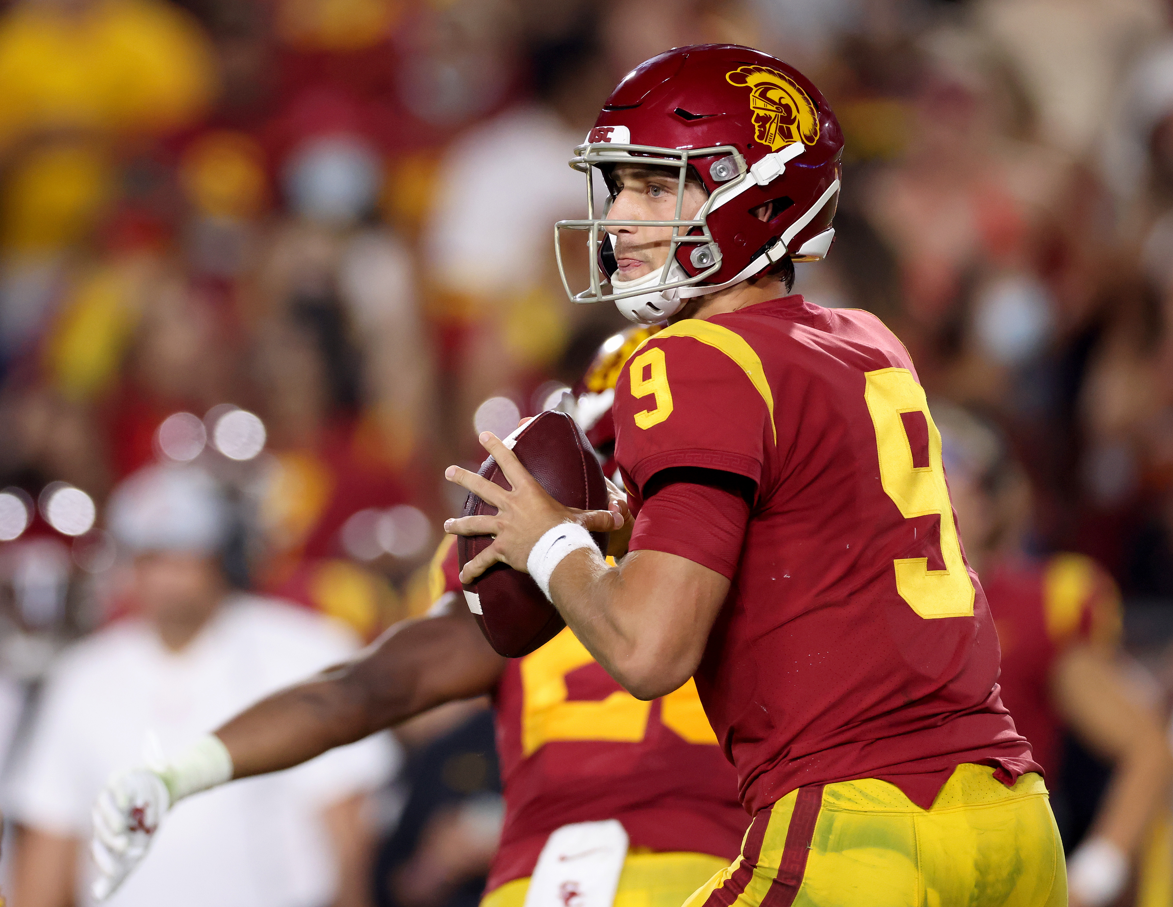 Kedon Slovis of the USC Trojans prepares to pass during a 42-28 loss to the Stanford Cardinal at Los Angeles Memorial Coliseum on September 11, 2021 in Los Angeles, California.