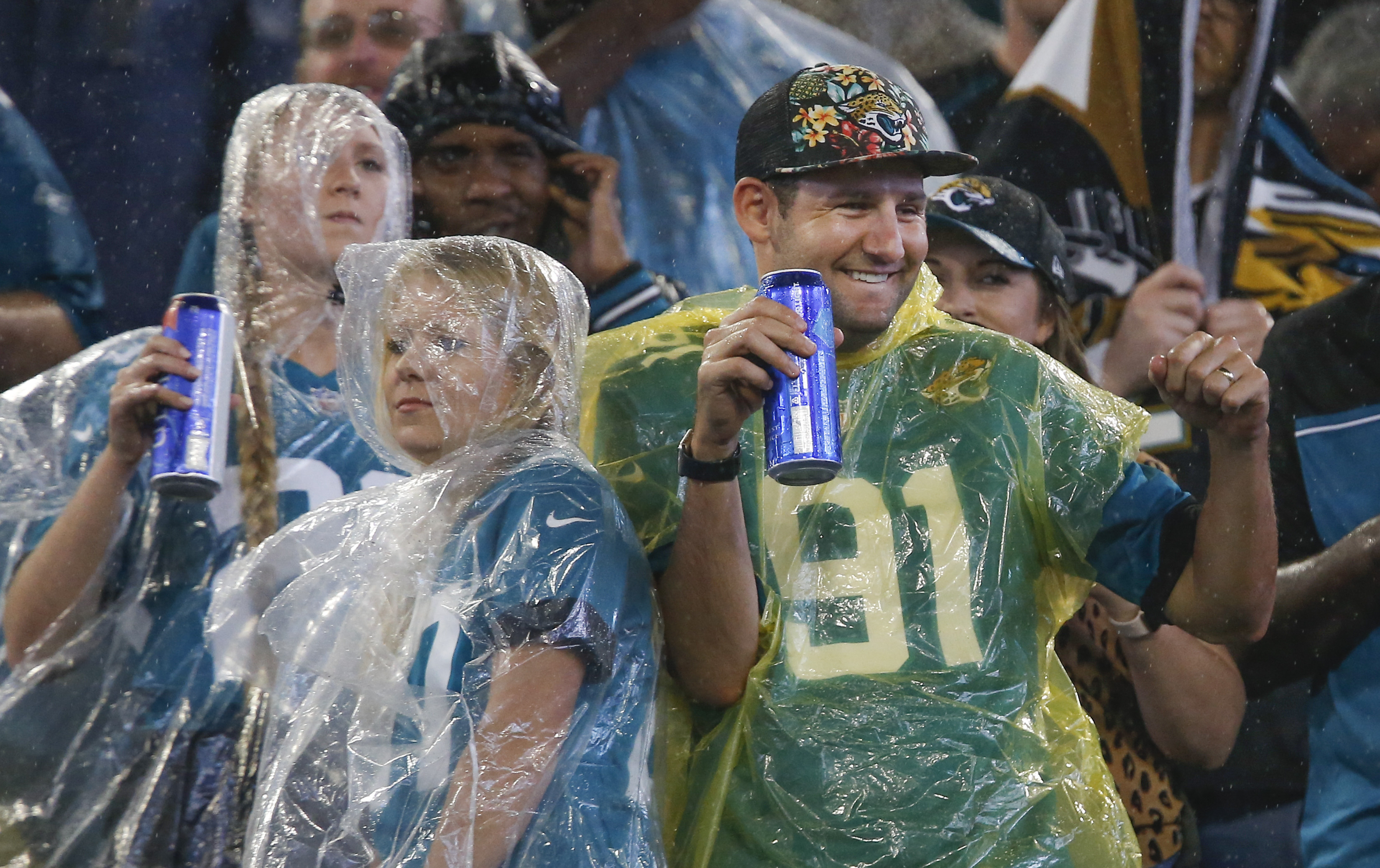 Sep 19, 2019; Jacksonville, FL, USA; Despite the rain Jacksonville Jaguars fans cheer during the second quarter against the Tennessee Titans at TIAA Bank Field.