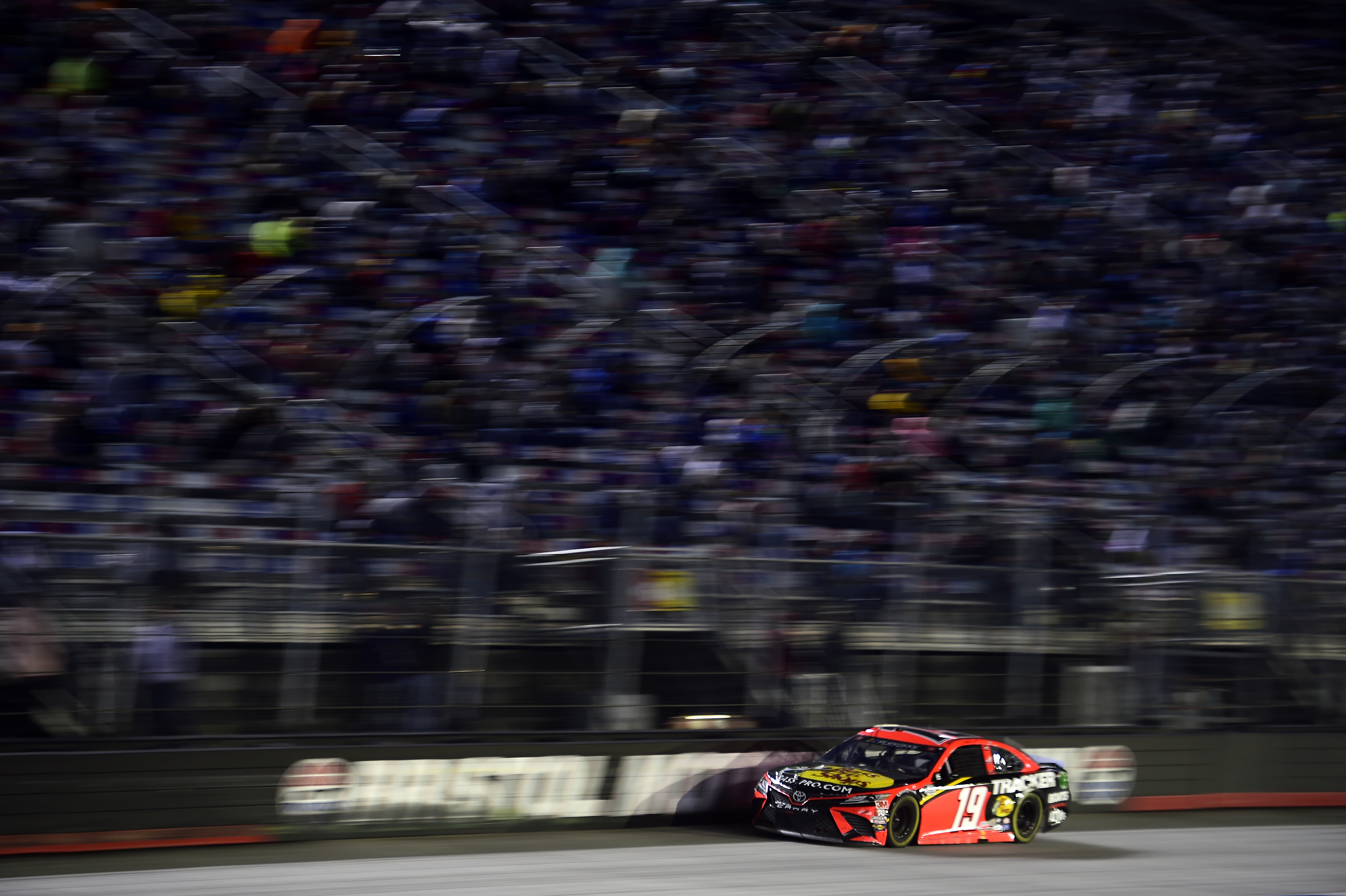 Martin Truex Jr., driver of the #19 Bass Pro Shops Toyota, races during the NASCAR Cup Series Bass Pro Shops Night Race at Bristol Motor Speedway on September 19, 2020 in Bristol, Tennessee.
